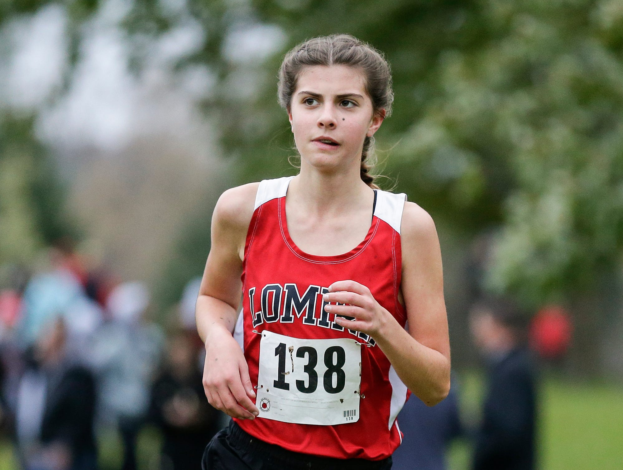 Lomira High School's Lydia Thomas runs in the WIAA Division two Mayville sectional cross country meet at the Mayville golf course Friday, October 19, 2018. Doug Raflik/USA TODAY NETWORK-Wisconsin