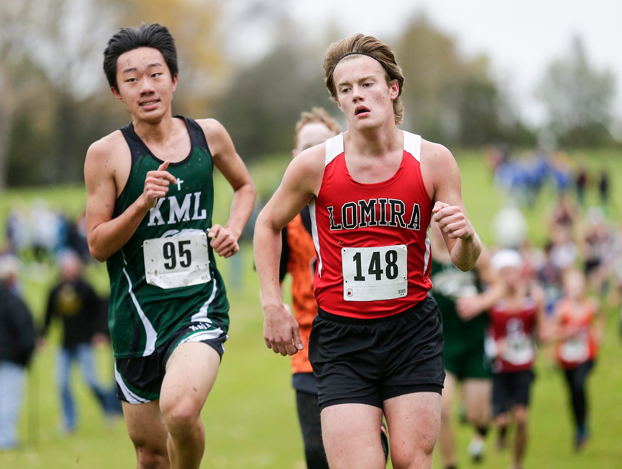 Lomira High School's Ian VanderGrinten and Kettle Moraine Lutheran's Isaiah Zhou run in the WIAA Division two Mayville sectional cross country meet at the Mayville golf course Friday, October 19, 2018. Doug Raflik/USA TODAY NETWORK-Wisconsin