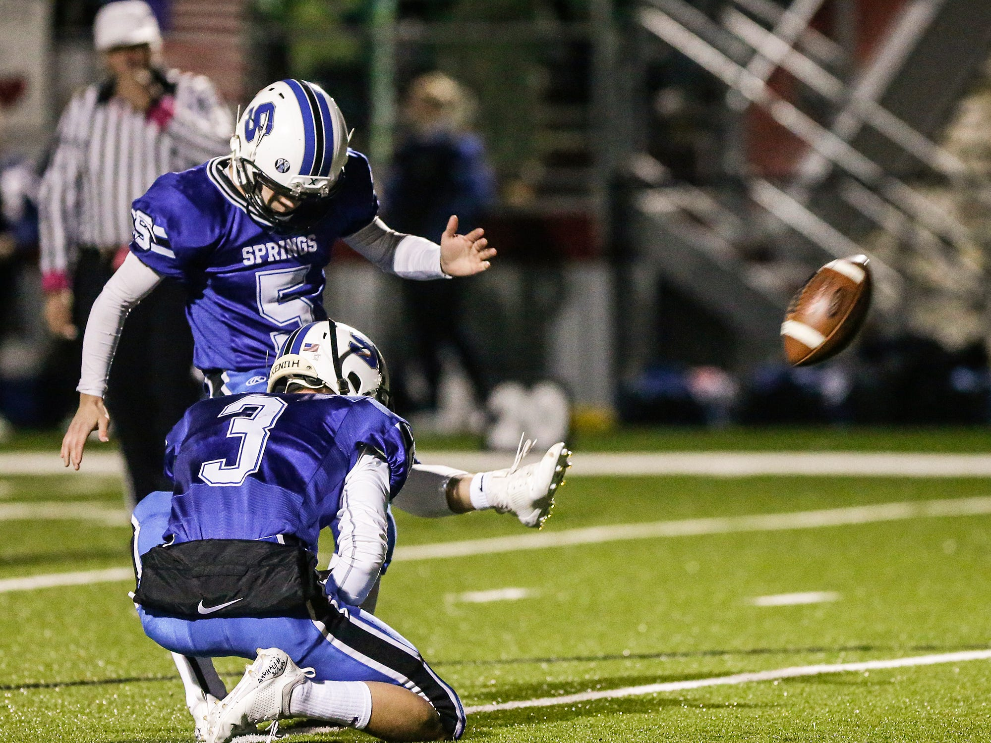 St. Mary's Springs Academy football's Levi Poss kicks this first quarter extra point against Dominican High School making the score 20-0  Friday, October 19, 2018 during their game played in Lomira, Wisconsin. Springs won the level 1 playoff game 62-13 Doug Raflik/USA TODAY NETWORK-Wisconsin