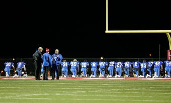 Fans, players and classmates paid their respects to Springs student and football player Trent Schueffner who died the morning of their playoff game.