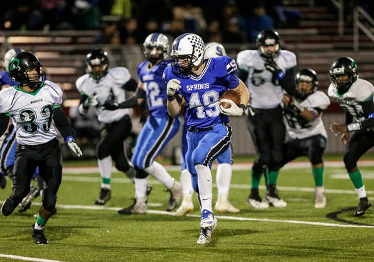 St. Mary's Springs' Jake Hoch runs against Dominican during Friday's playoff game in Lomira