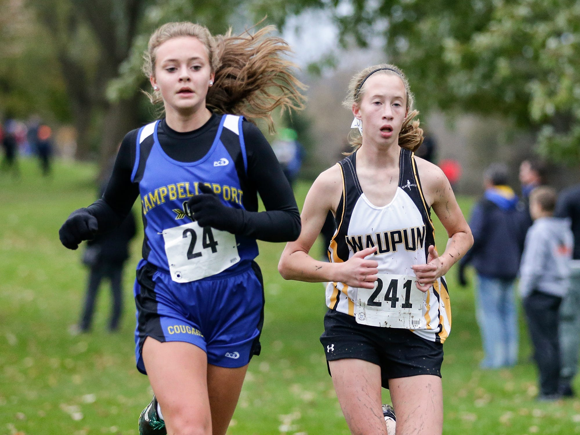 Campbellsport High School's Calla Loehr and Waupun's Naomi Aalsms run in the WIAA Division two Mayville sectional cross country meet at the Mayville golf course Friday, October 19, 2018. Doug Raflik/USA TODAY NETWORK-Wisconsin