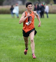North Fond du Lac's Diego Charbonneau makes his way to the finish line in the WIAA Division 2 Mayville sectional cross country meet Friday. Charbonneau finished third overall to advance to state.