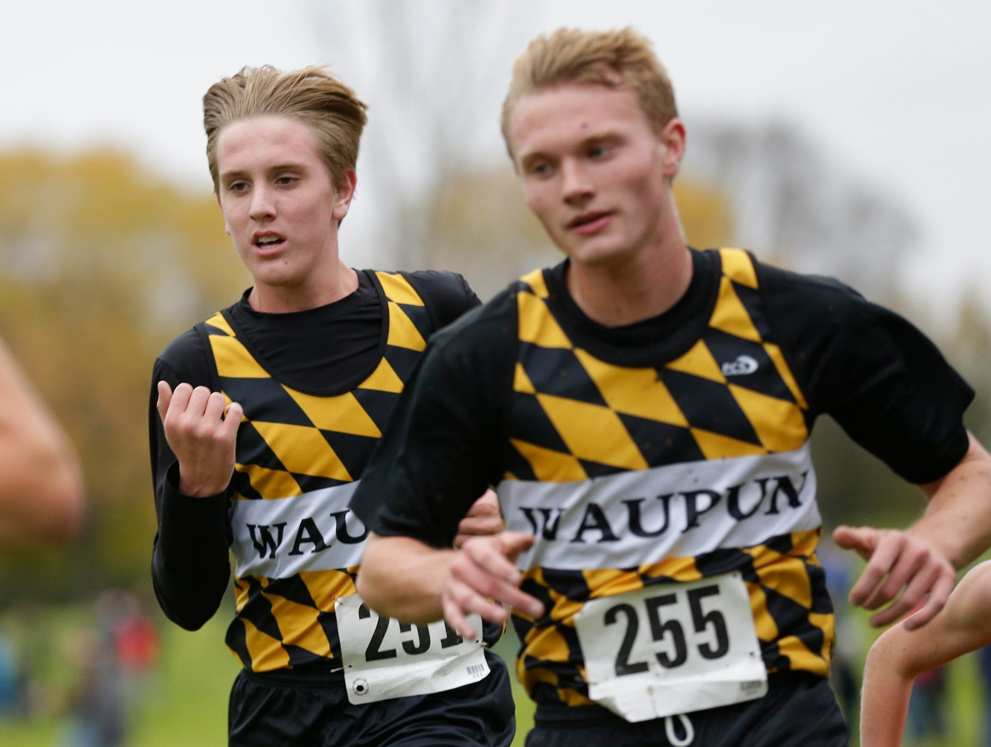Waupun High School's Levi Kastein (251) and Kanon Smit (255) run in the WIAA Division two Mayville sectional cross country meet at the Mayville golf course Friday, October 19, 2018. Doug Raflik/USA TODAY NETWORK-Wisconsin