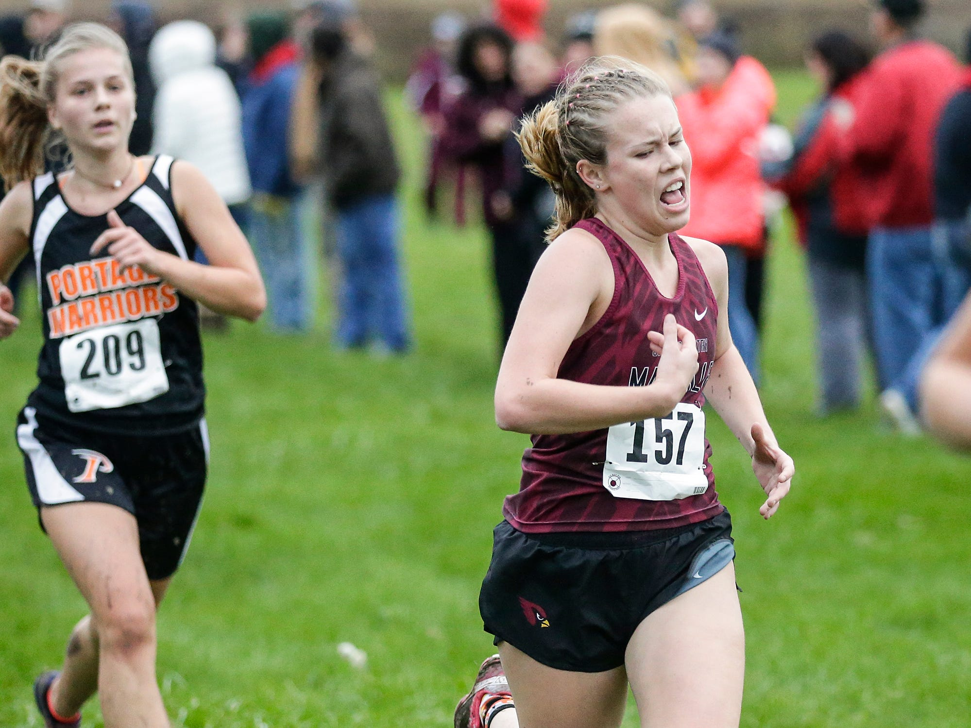 Mayville High School's Catlyn Mahoney runs in the WIAA Division two Mayville sectional cross country meet at the Mayville golf course Friday, October 19, 2018. Doug Raflik/USA TODAY NETWORK-Wisconsin
