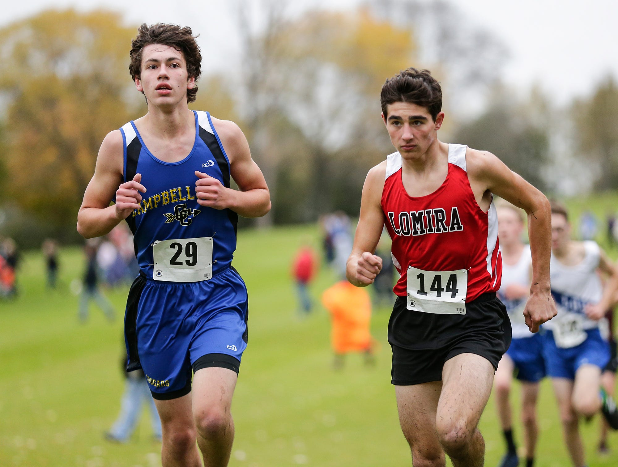Campbellsport High School's Jared Engel and Lomira High School's Alex Gundrum run in the WIAA Division two Mayville sectional cross country meet at the Mayville golf course Friday, October 19, 2018. Doug Raflik/USA TODAY NETWORK-Wisconsin