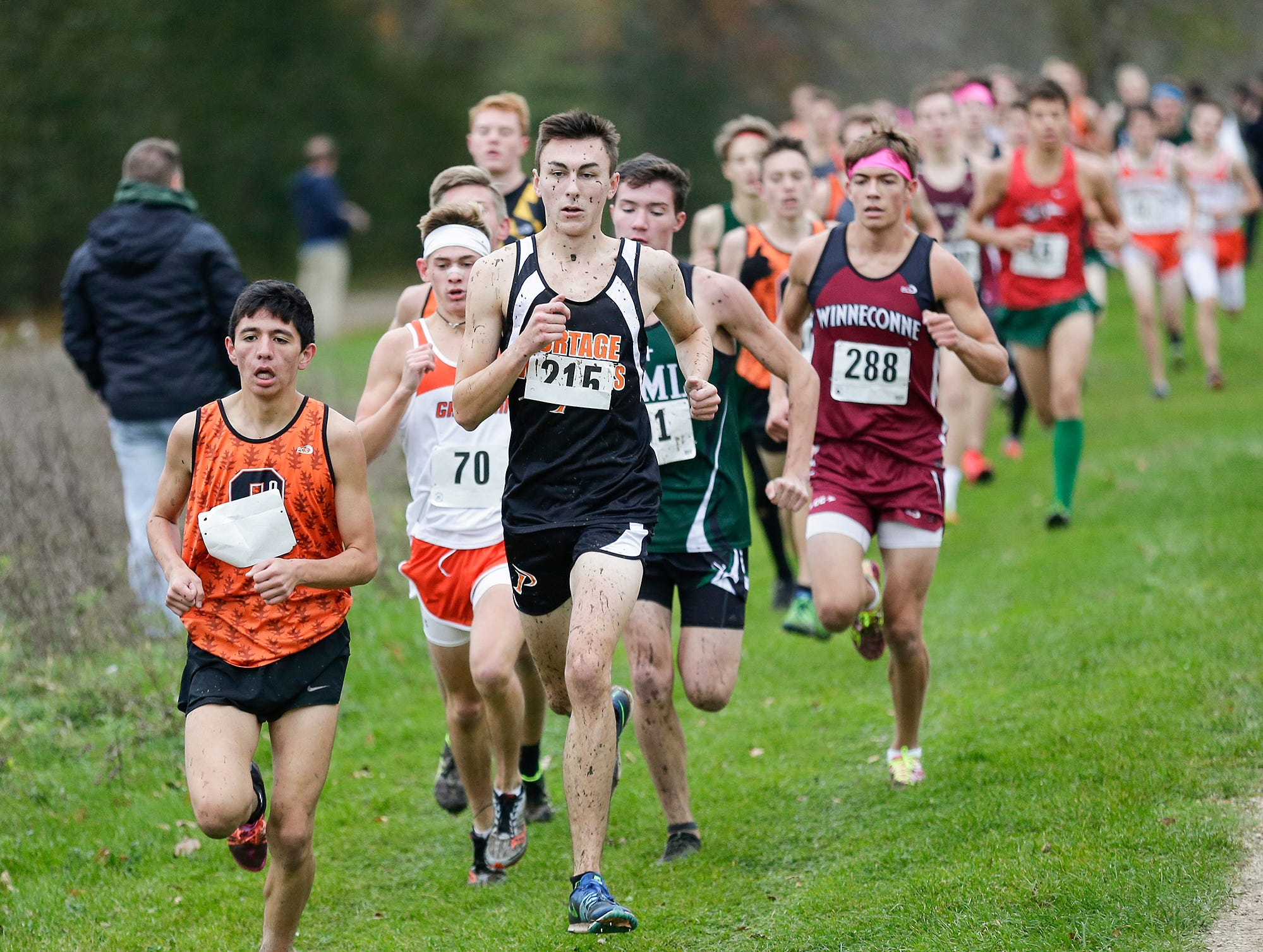 North Fond du Lac High School's Diego Charbonneau leads a pack of runners in the WIAA Division two Mayville sectional cross country meet at the Mayville golf course Friday, October 19, 2018. Doug Raflik/USA TODAY NETWORK-Wisconsin