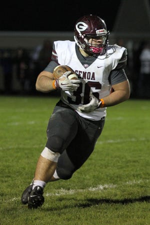 Genoa's Daniel Novotney carries the football against Eastwood.