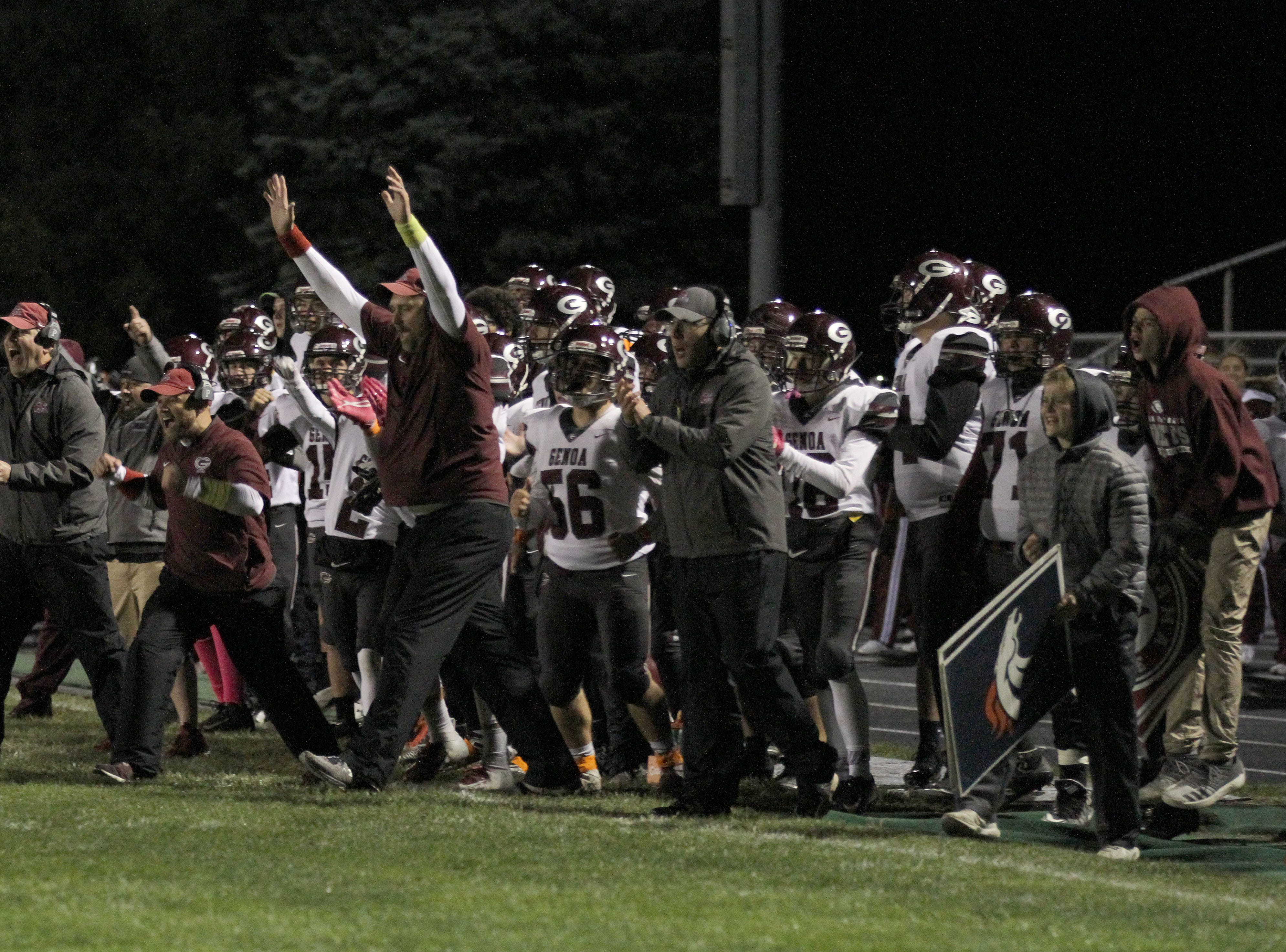 Genoa's sideline erupts after a successful goal line stand against Eastwood, as the first half expired.