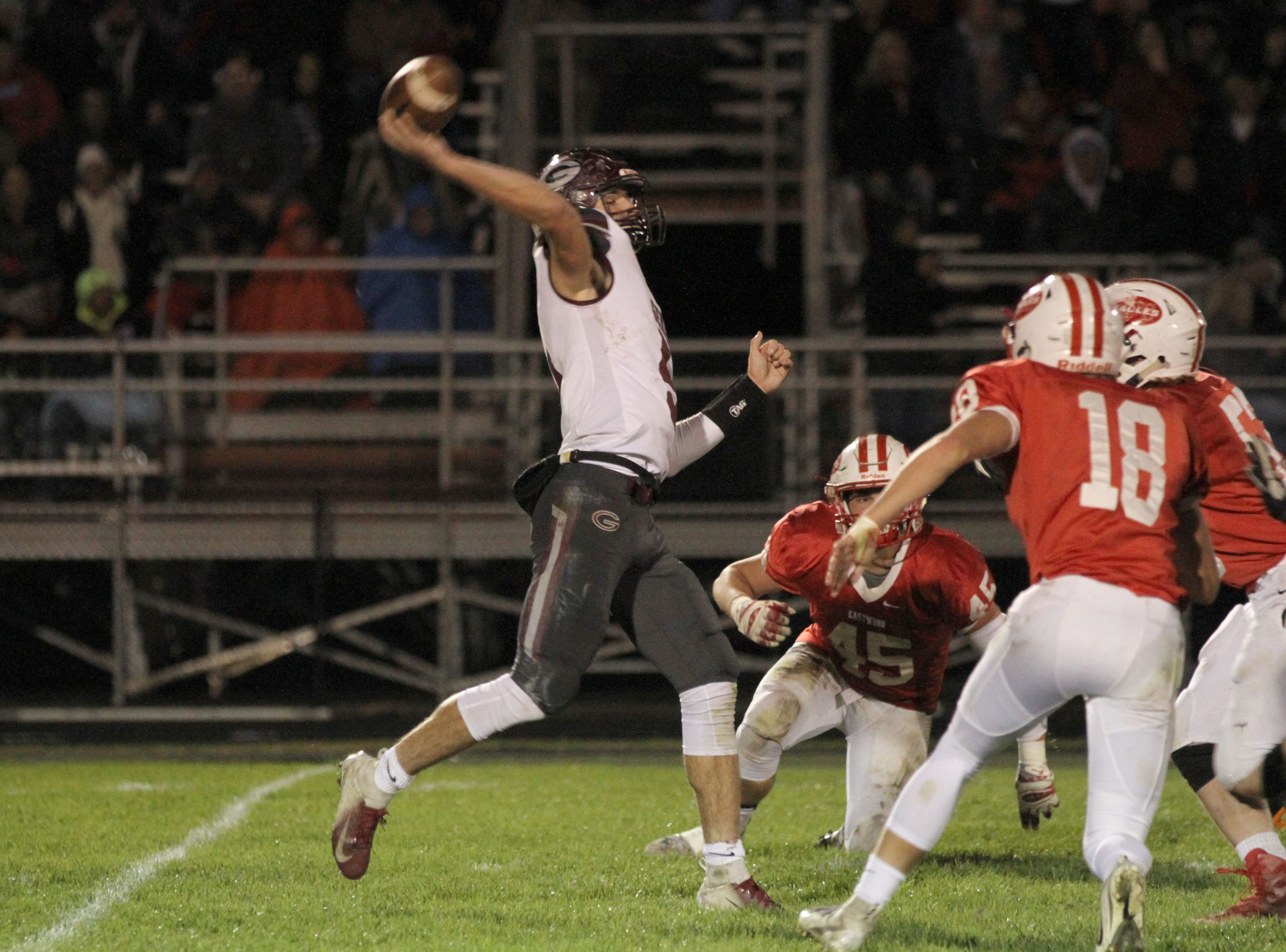 Genoa's Jacob Plantz throws for a touchdown to Nathan Lewis in first half action against Eastwood.