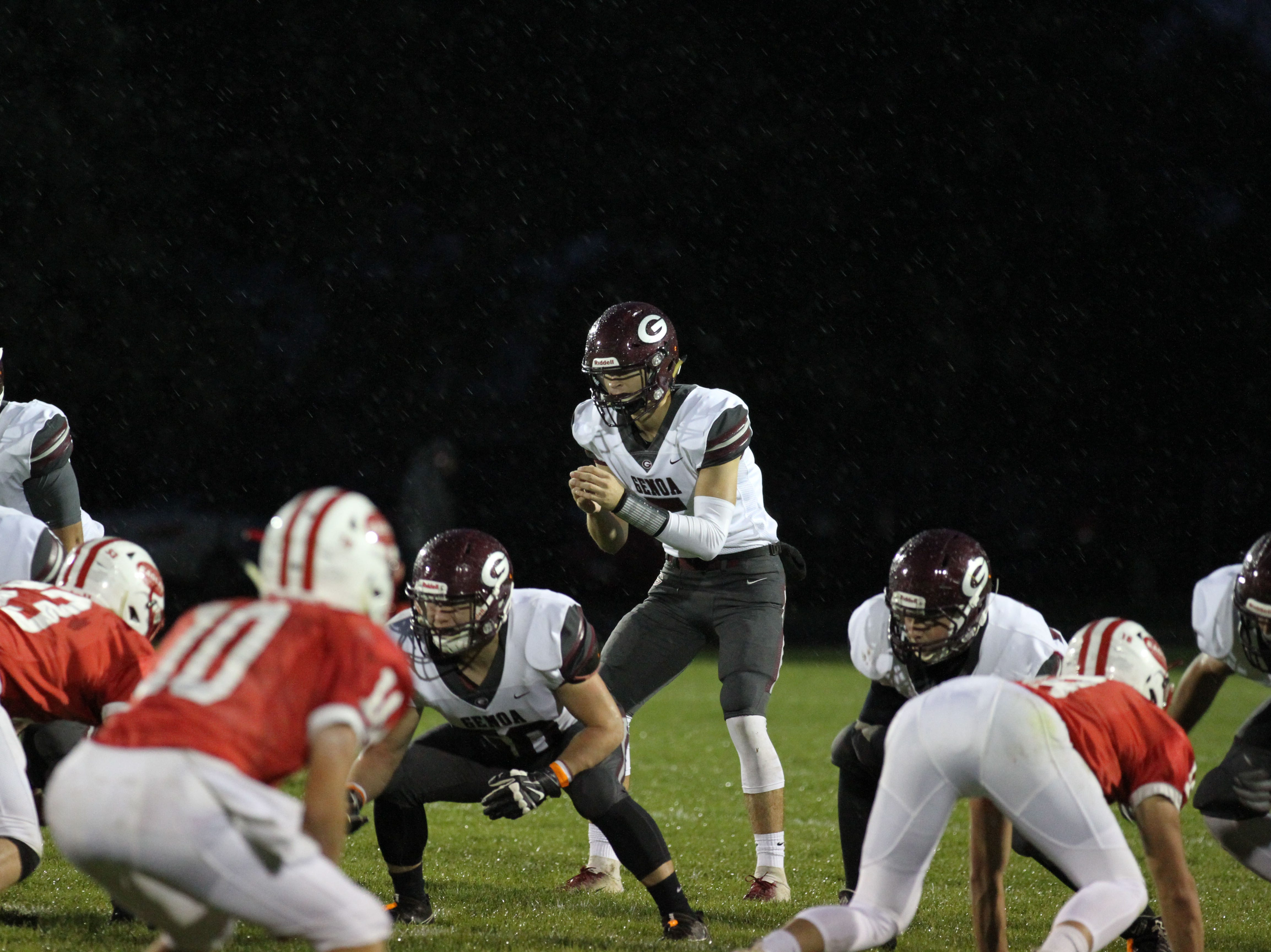 Genoa's Jacob Plant waits for the snap in the driving rain against Eastwood.