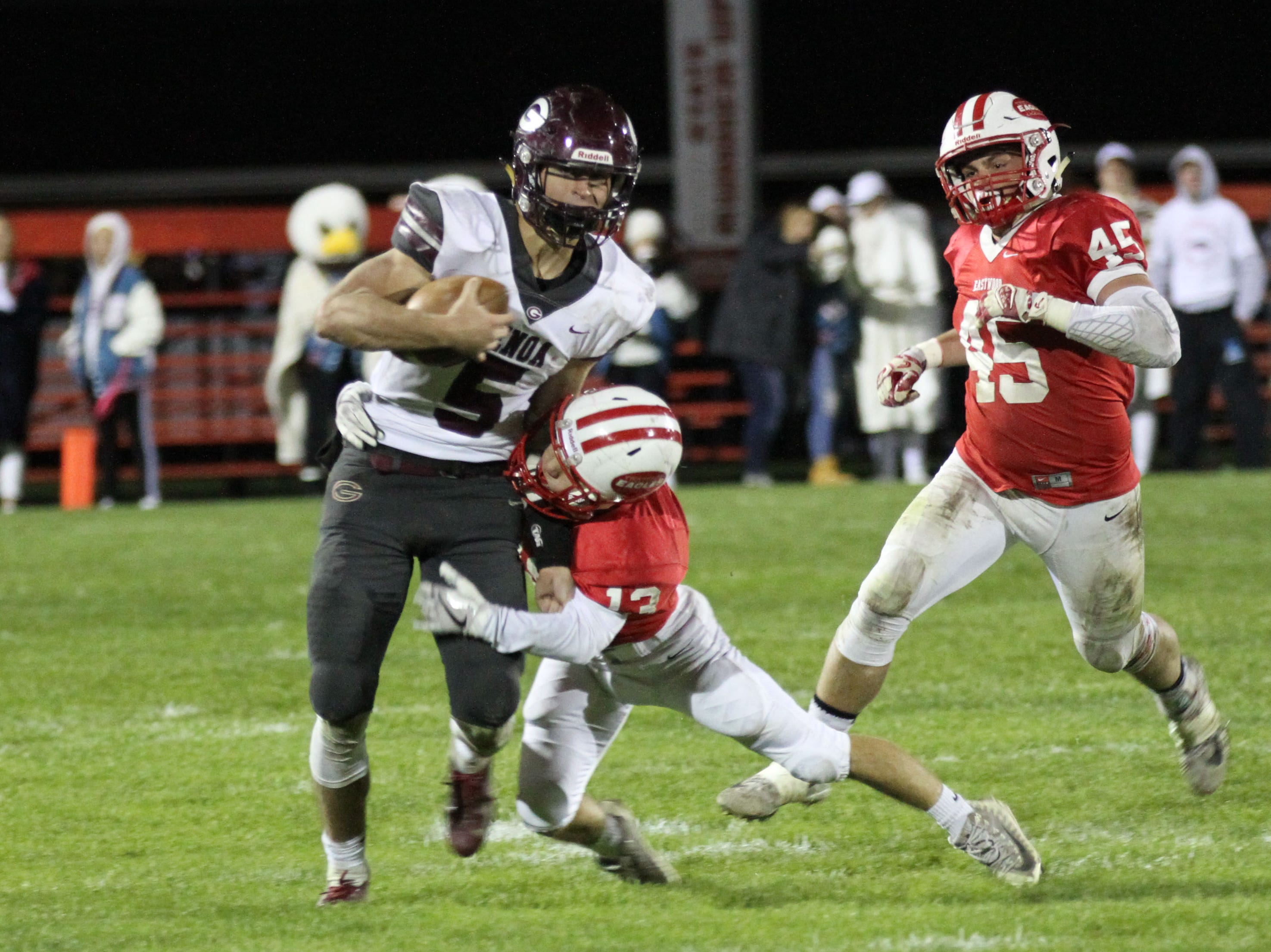 Genoa's Jacob Plantz carries the football against Eastwood.