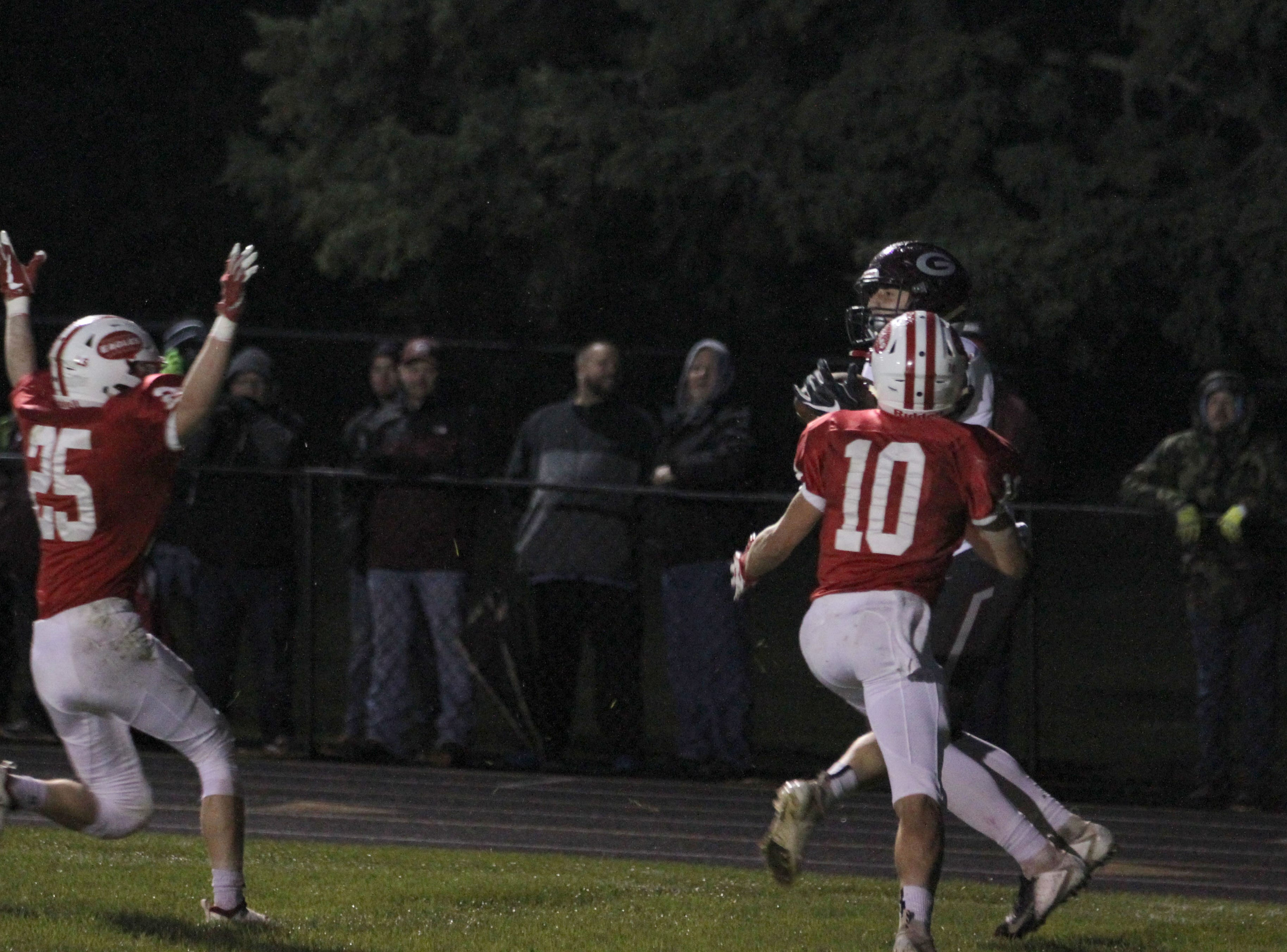 Genoa's Nathan Lewis hauls the pass in for a touchdown against Eastwood.