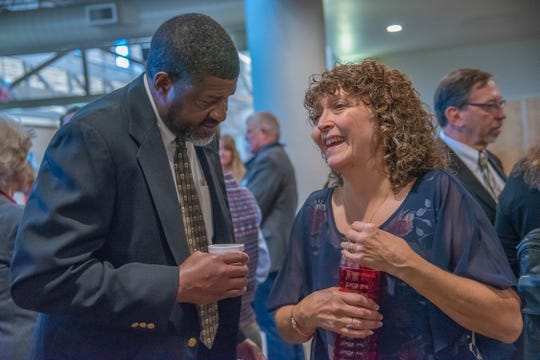 Jeannette Gaiter, widow of former Larimer County Commissioner Lew Gaiter, speaks with her brother-in-law Byron Gaiter at the conclusion of a memorial service for her husband at Timerbline Church in Fort Collins on Saturday, Oct. 20, 2018.