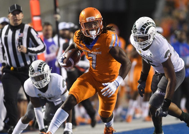 Boise State wide receiver A.J. Richardson (7) runs the ball against Colorado State's defense in an NCAA college football game in Boise, Idaho, Friday, Oct. 19, 2018.