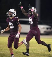Riverdale High School's Derick Sapp, right, celebrates recovering a fumble against Golden Gate on Friday at Riverdale High School in Fort Myers.
