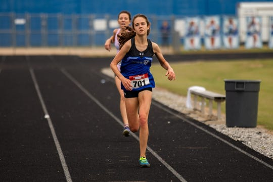 Ava Dobson of St. Joseph's (701) finishes just ahead of Greer Middle College's Morgan Summey in the girls race of Saturday's Ed Boehmke Greenville County cross country championships at Woodmont High School.