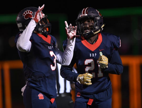 Belton Honea Path's Bralyn Oliver (21) celebrates with Xavier Nance (3) after scoring against Wren Friday, October 19, 2018 at Belton Honea Path's Marlee Gambrell Field.