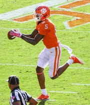 Clemson wide receiver Tee Higgins (5) catches a ball for a touchdown near NC State corner back Nick McCloud (4) during the first quarter in Memorial Stadium on Saturday, October 20, 2018.