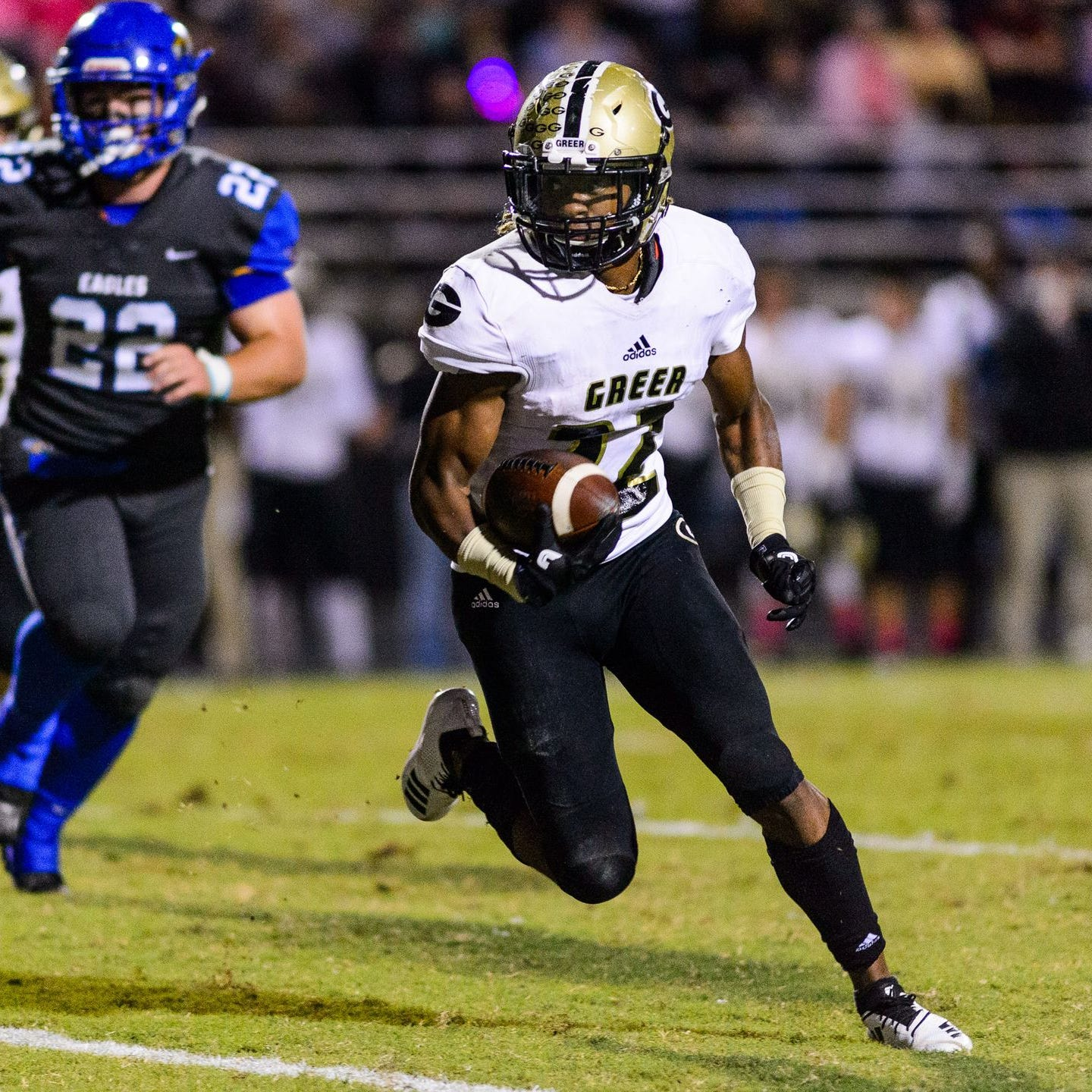 Greer's Dre Williams, right, turns the corner to score on a 14-yard run in the second quarter of the Yellow Jackets' 59-28 win over Eastside Friday night.