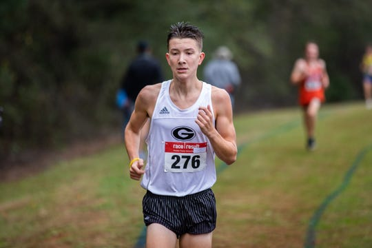 Greer's Coen Roberts (276) leads the pack on his way to victory in the boys race of the Ed Boehmke Greenville County cross country championships Saturday at Woodmont High School.