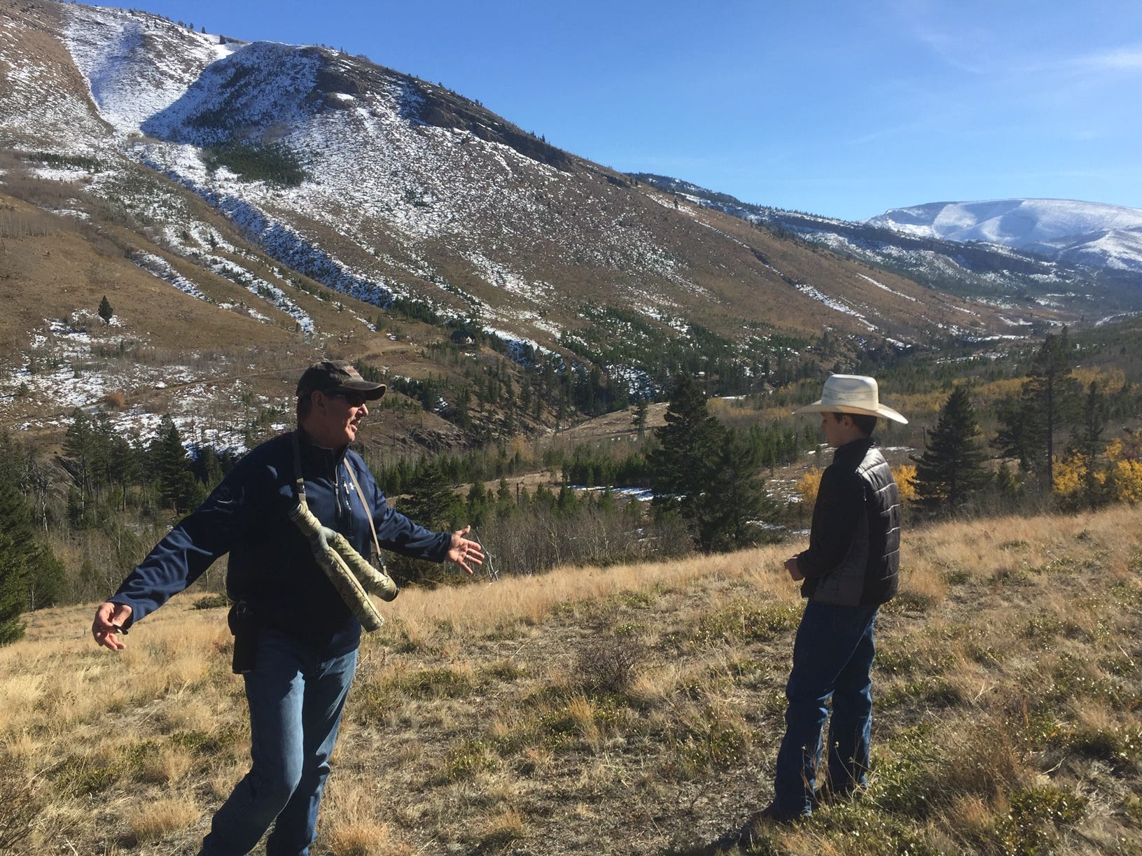Mike Mueller of the Rocky Mountain Elk Foundation chats with Wyatt Barrett on the Barrett property west of Augusta. The area is prime elk habitat, and protecting it is a national priority for the foundation.