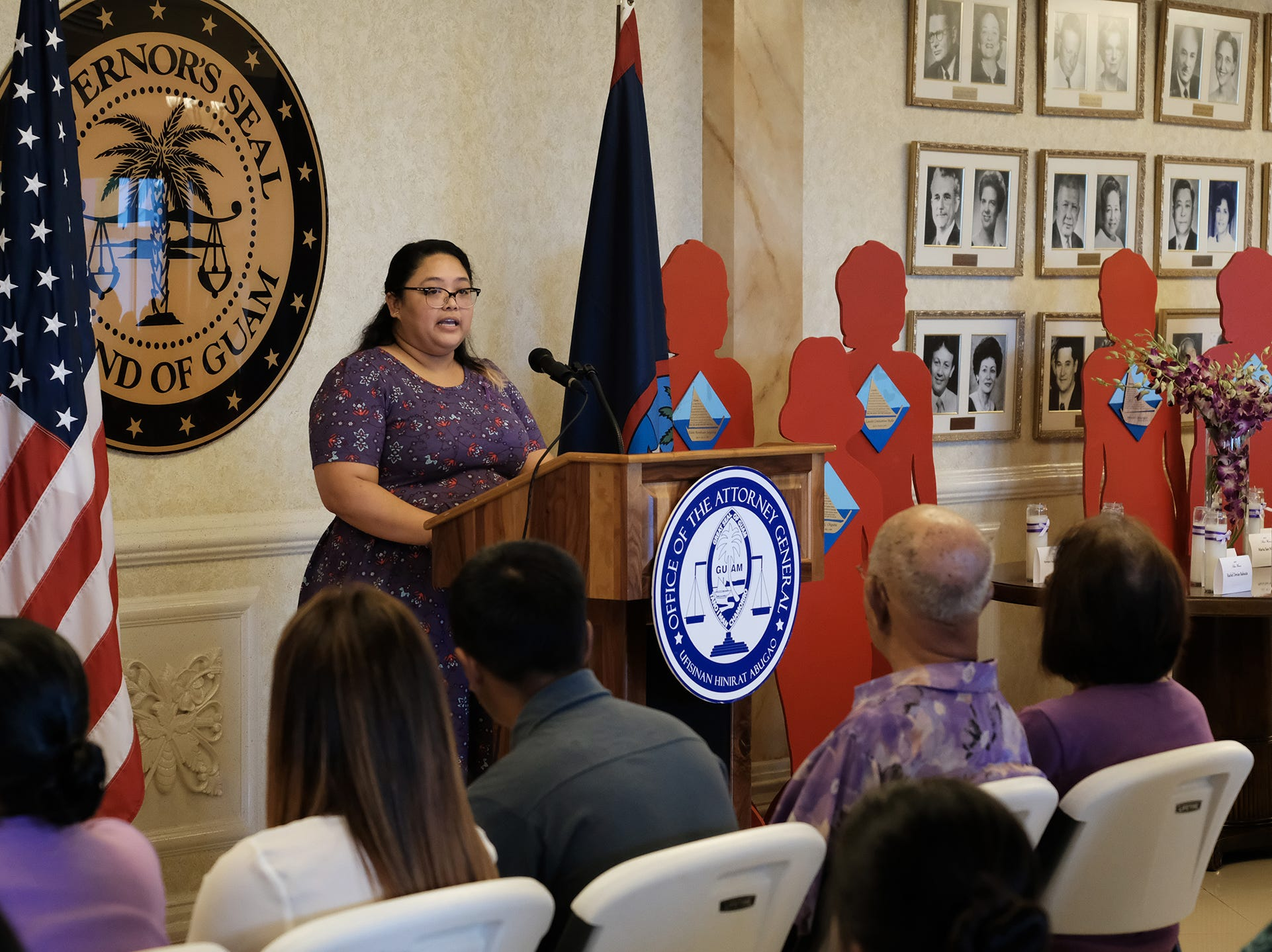 Melissa Ann Duenas Quinata, niece of silent witness Melissa Ann Quinata, gives the keynote speech about her family's experience with domestic violence at the 2018 Silent Witness Ceremony at Government House Oct. 19, 2018.