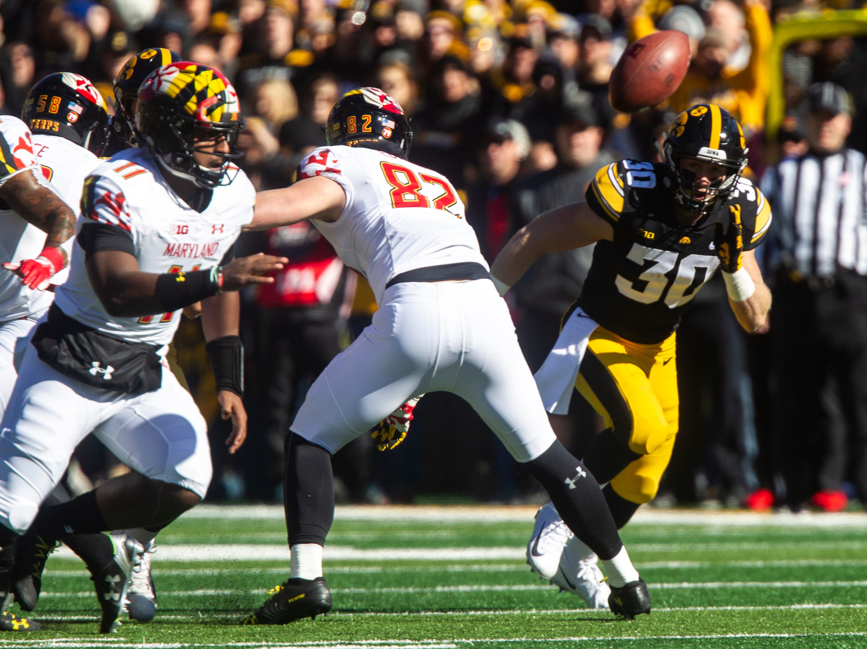 Iowa defensive back Jake Gervase (30) chases down the ball Maryland quarterback Kasim Hill (11) bobbled from the snap during an NCAA Big Ten conference football game on Saturday, Oct. 20, 2018, at Kinnick Stadium in Iowa City.