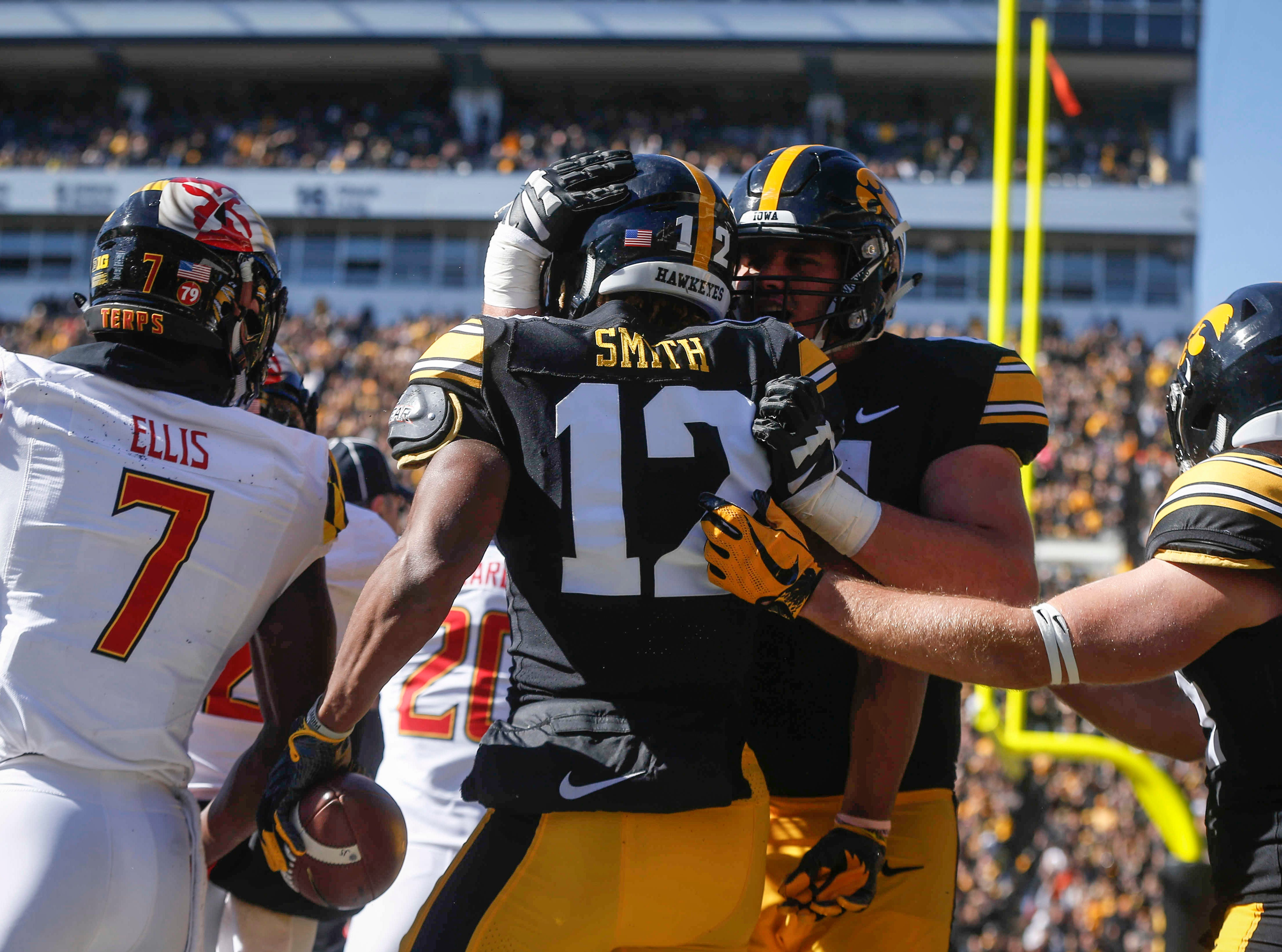 Members of the Iowa offense celebrate after Brandon Smith pulled in a touchdown pass in the end zone against Maryland on Saturday, Oct. 20, 2018, at Kinnick Stadium in Iowa City.