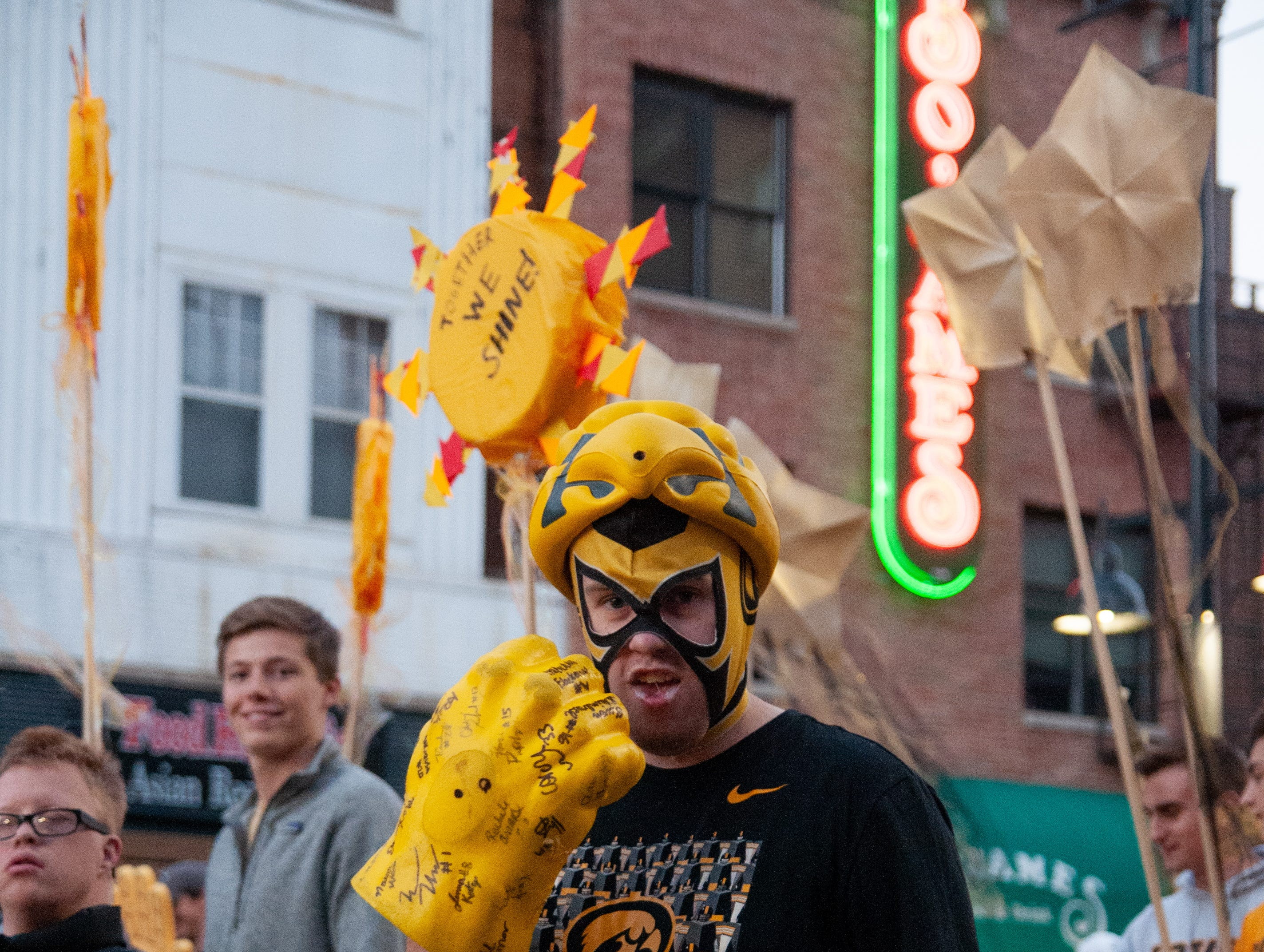 """""""Hawkeye Libre"""" Owen Steinbrech, 22, marches in the 2018 Homecoming parade, Friday, Oct. 19, 2018, in Iowa City."""