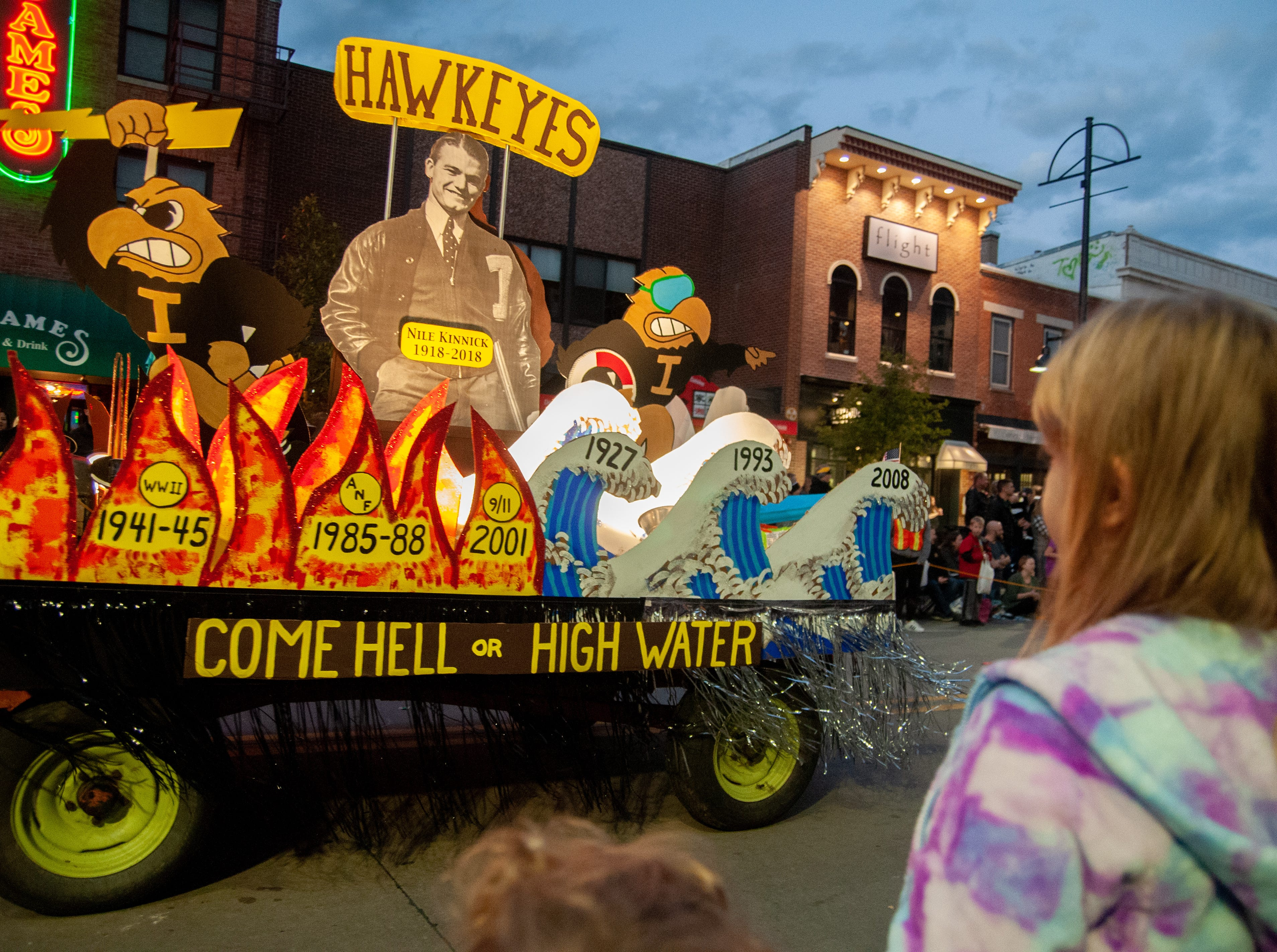 A float celebrating Nile Kinnick's 100th birthday rolls through the 2018 Homecoming parade, Friday, Oct. 19, 2018, in Iowa City.