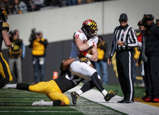 Iowa linebacker Djimon Colbert forces Maryland's Avery Edwards out of bounds on Saturday, Oct. 20, 2018, at Kinnick Stadium in Iowa City.