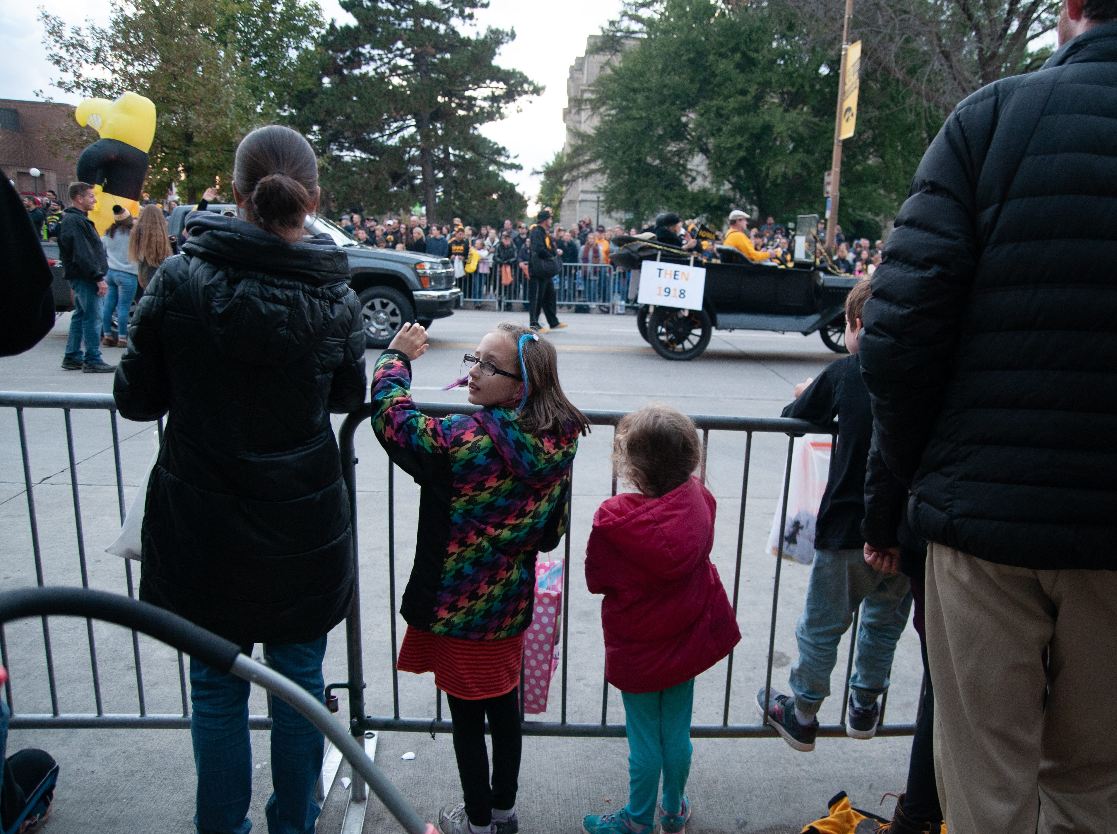 Kids line Clinton Street for the 2018 Homecoming parade, Friday, Oct. 19, 2018, in Iowa City.