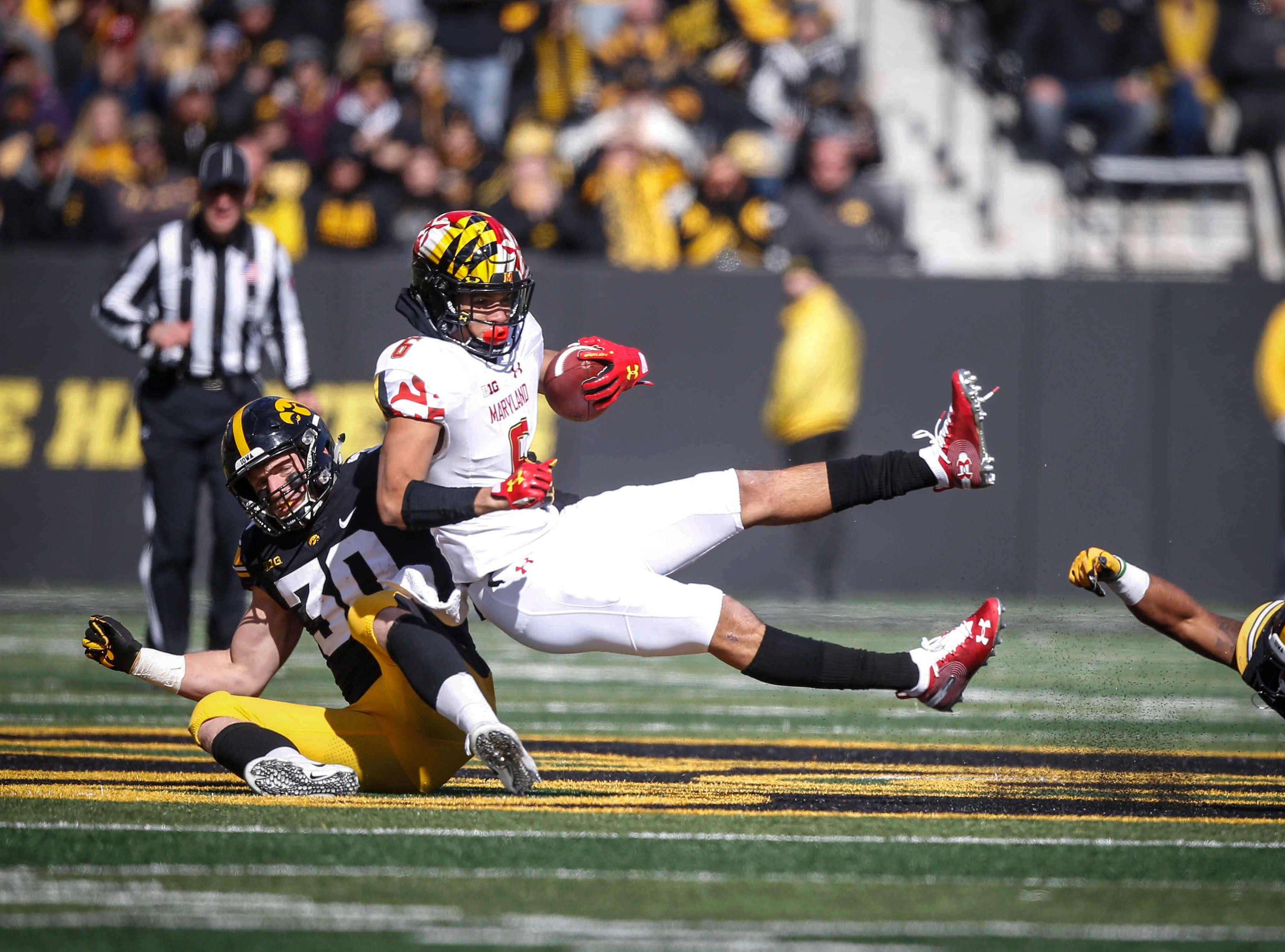 Iowa safety Jake Gervase pulls Maryland receiver Jeshaun Jones down in the third quarter on Saturday, Oct. 20, 2018, at Kinnick Stadium in Iowa City.