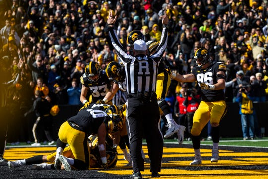 Iowa defensive end Anthony Nelson (98) dives on a fumbled ball in the end zone for a touchdown during an NCAA Big Ten conference football game on Saturday, Oct. 20, 2018, at Kinnick Stadium in Iowa City.