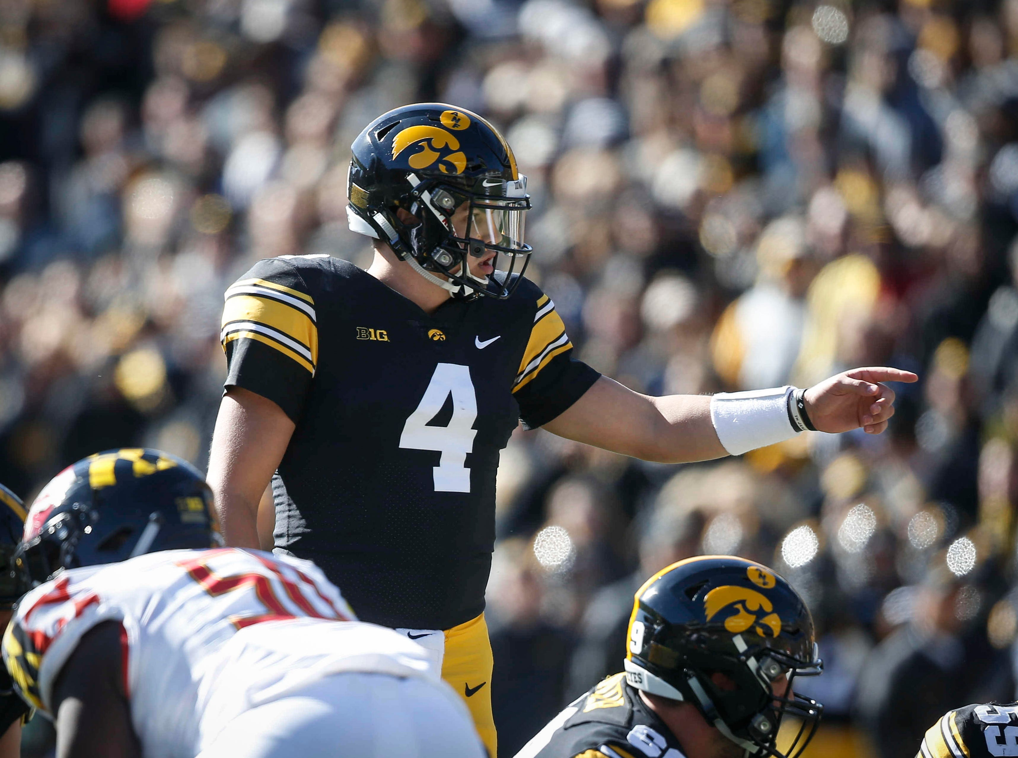 Iowa quarterback Nate Stanley directs a play against Maryland on Saturday, Oct. 20, 2018, at Kinnick Stadium in Iowa City.