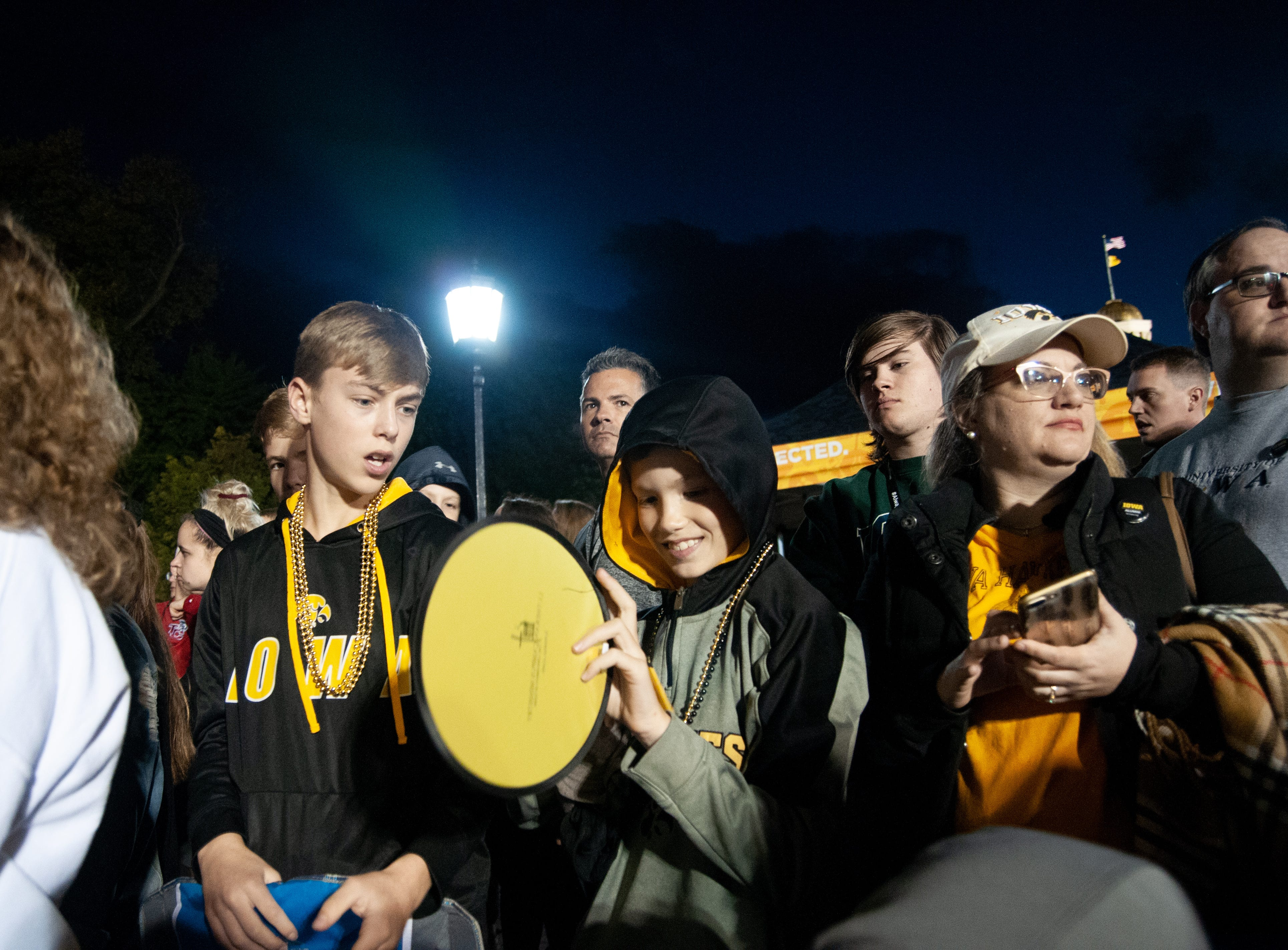 Ben Claussen, 10, admires his new frisbee during the 2018 Homecoming parade, Friday, Oct. 19, 2018, in Iowa City.