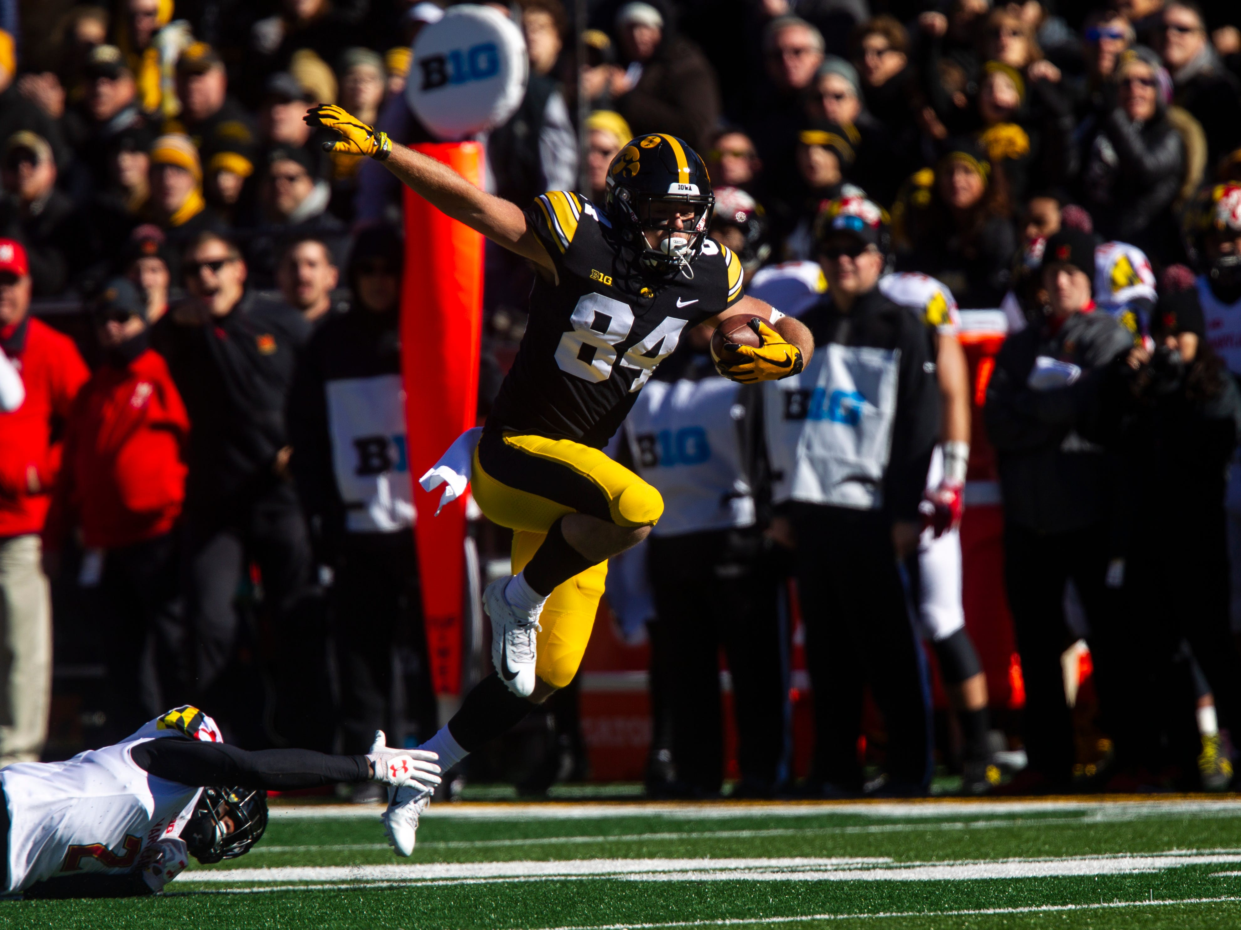 Iowa wide receiver Nick Easley (84) steps out of a tackle from Maryland defensive back RaVon Davis (2) during an NCAA Big Ten conference football game on Saturday, Oct. 20, 2018, at Kinnick Stadium in Iowa City.