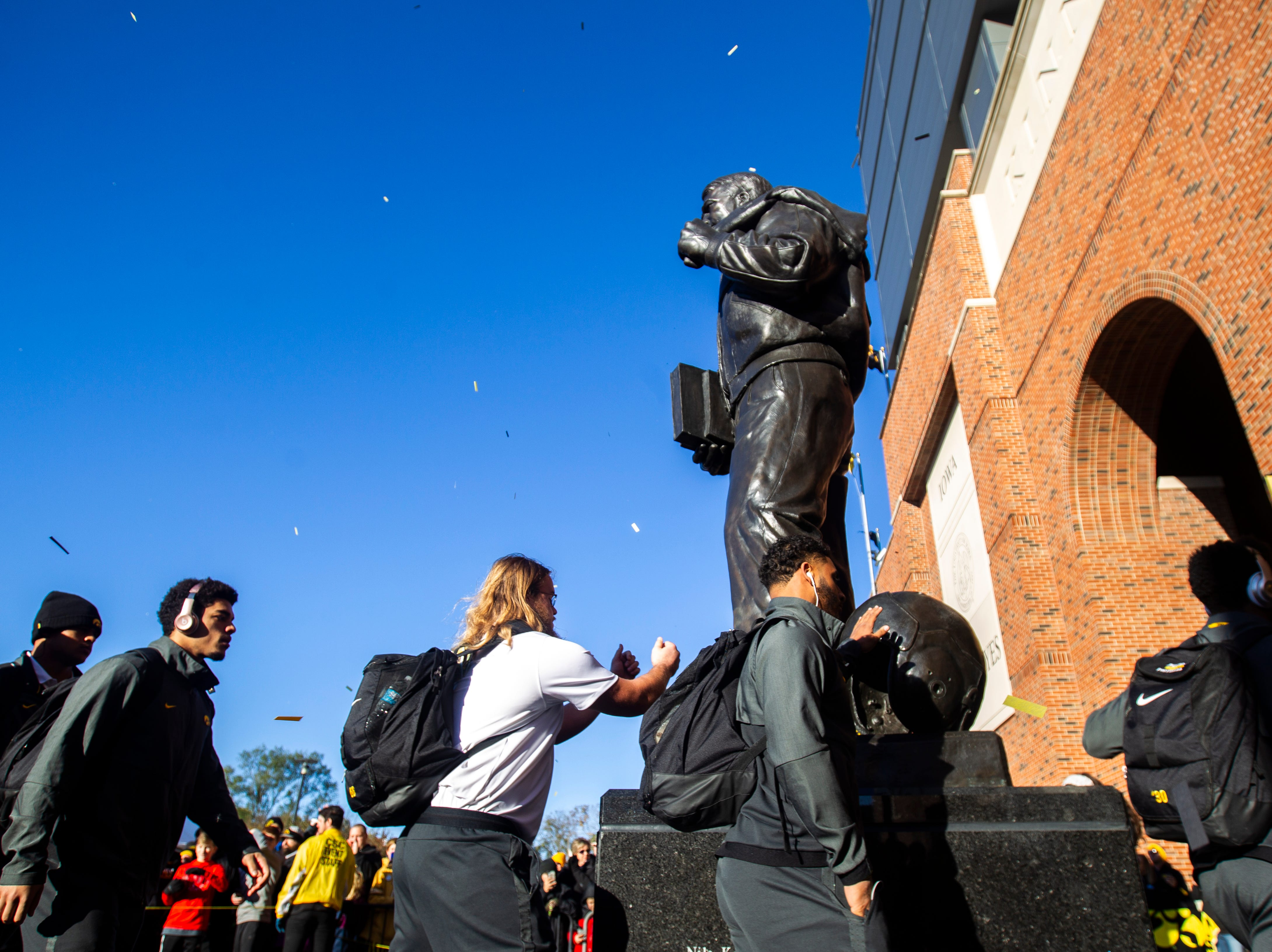 Iowa players walk past a statue of Nile Kinnick while entering the stadium before an NCAA Big Ten football game on Saturday, Oct. 20, 2018, at Kinnick Stadium in Iowa City.