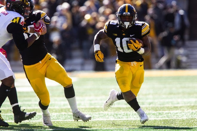 Iowa running back Mekhi Sargent (10) rushes during an NCAA Big Ten conference football game on Saturday, Oct. 20, 2018, at Kinnick Stadium in Iowa City.