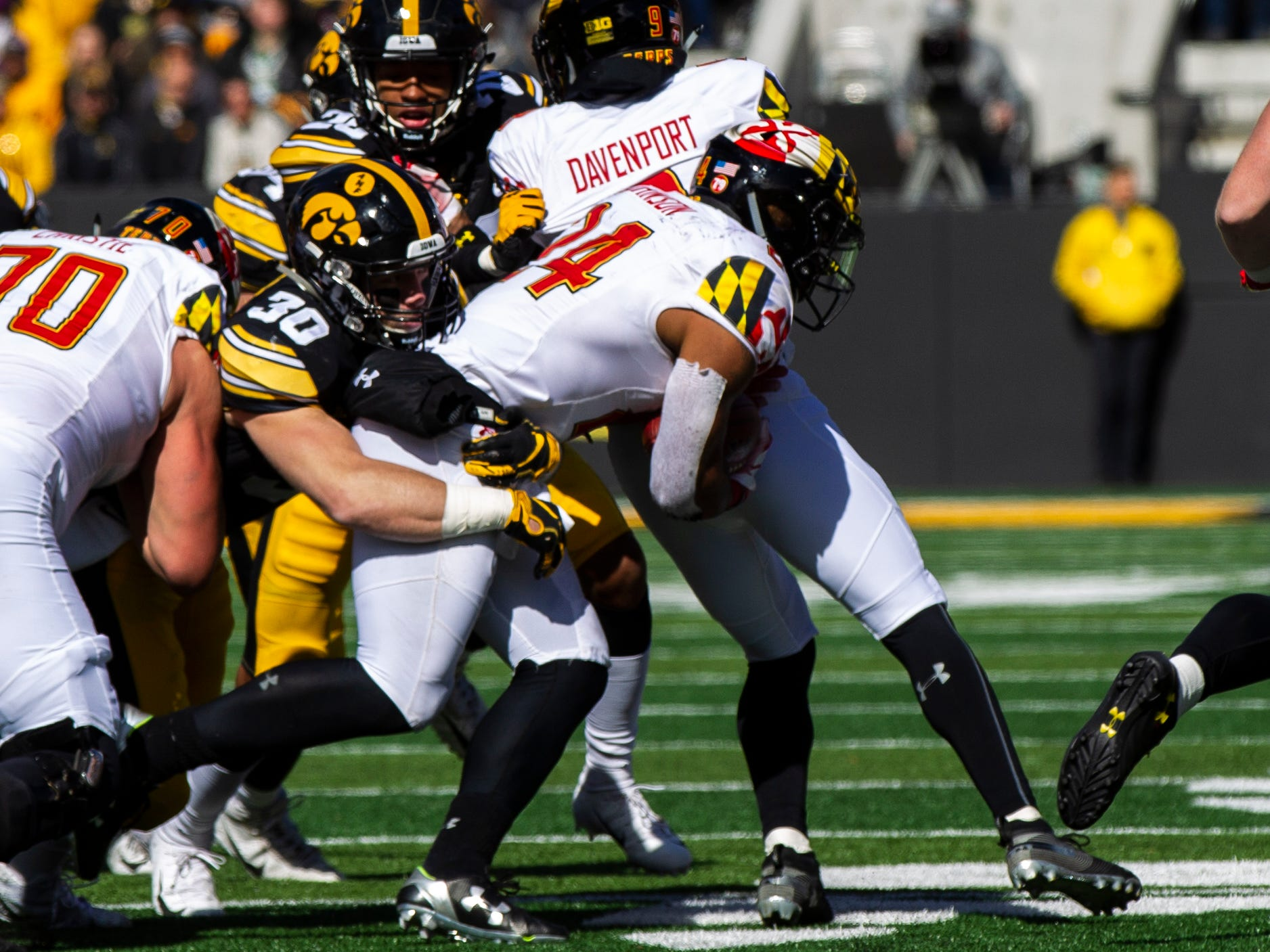 Iowa defensive back Jake Gervase (30) tackles Maryland wide receiver Tahj Capehart (14) during an NCAA Big Ten conference football game on Saturday, Oct. 20, 2018, at Kinnick Stadium in Iowa City.