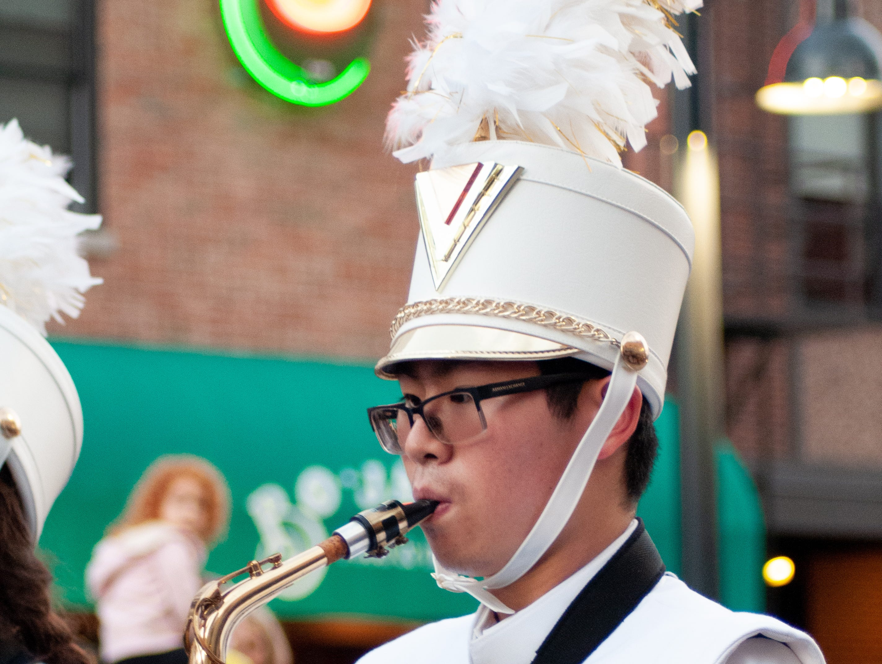 Yangtian Shangguan performs in the Iowa City West High Marching Band for the 2018 Homecoming parade, Friday, Oct. 19, 2018, in Iowa City.