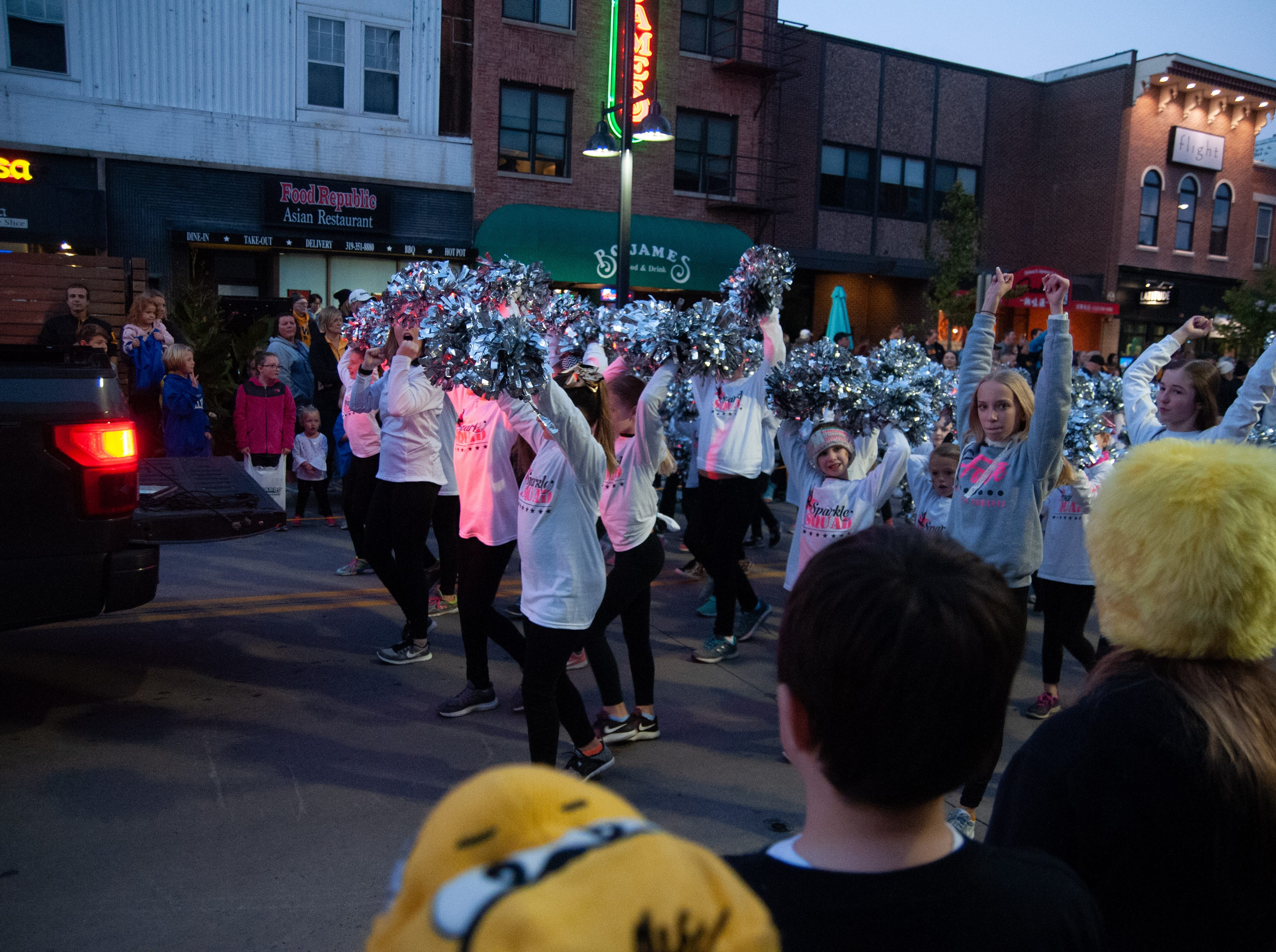 The Sparkle Squad cheers in the 2018 Homecoming parade, Friday, Oct. 19, 2018, in Iowa City.