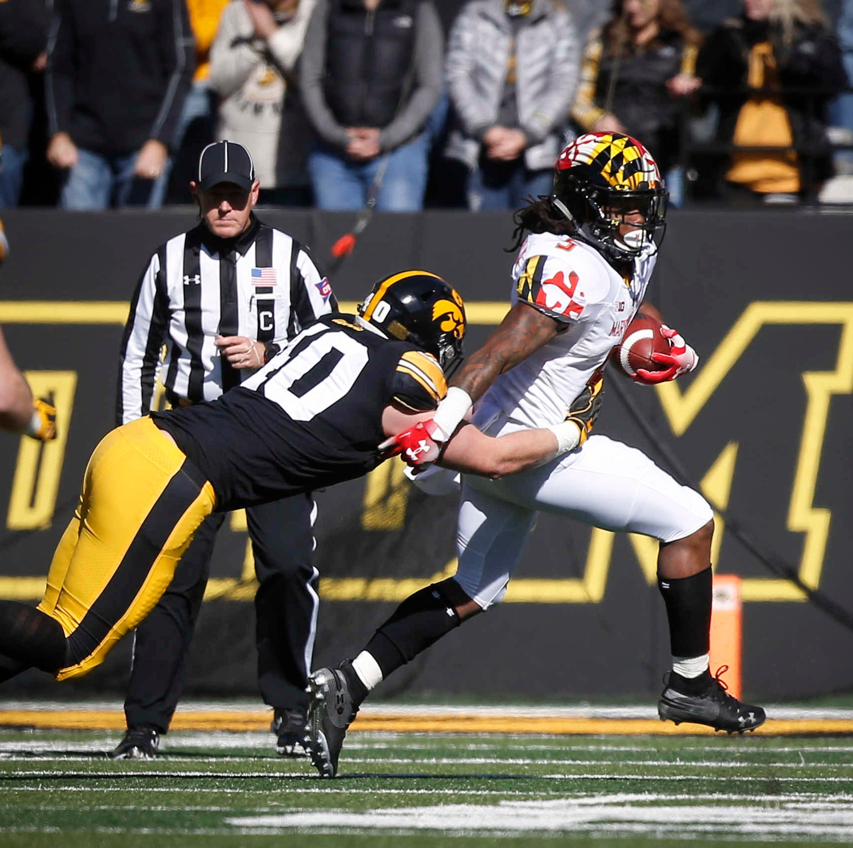 Iowa's Parker Hesse catches Maryland running back Anthony McFarland for a loss on Saturday, Oct. 20, 2018, at Kinnick Stadium in Iowa City.