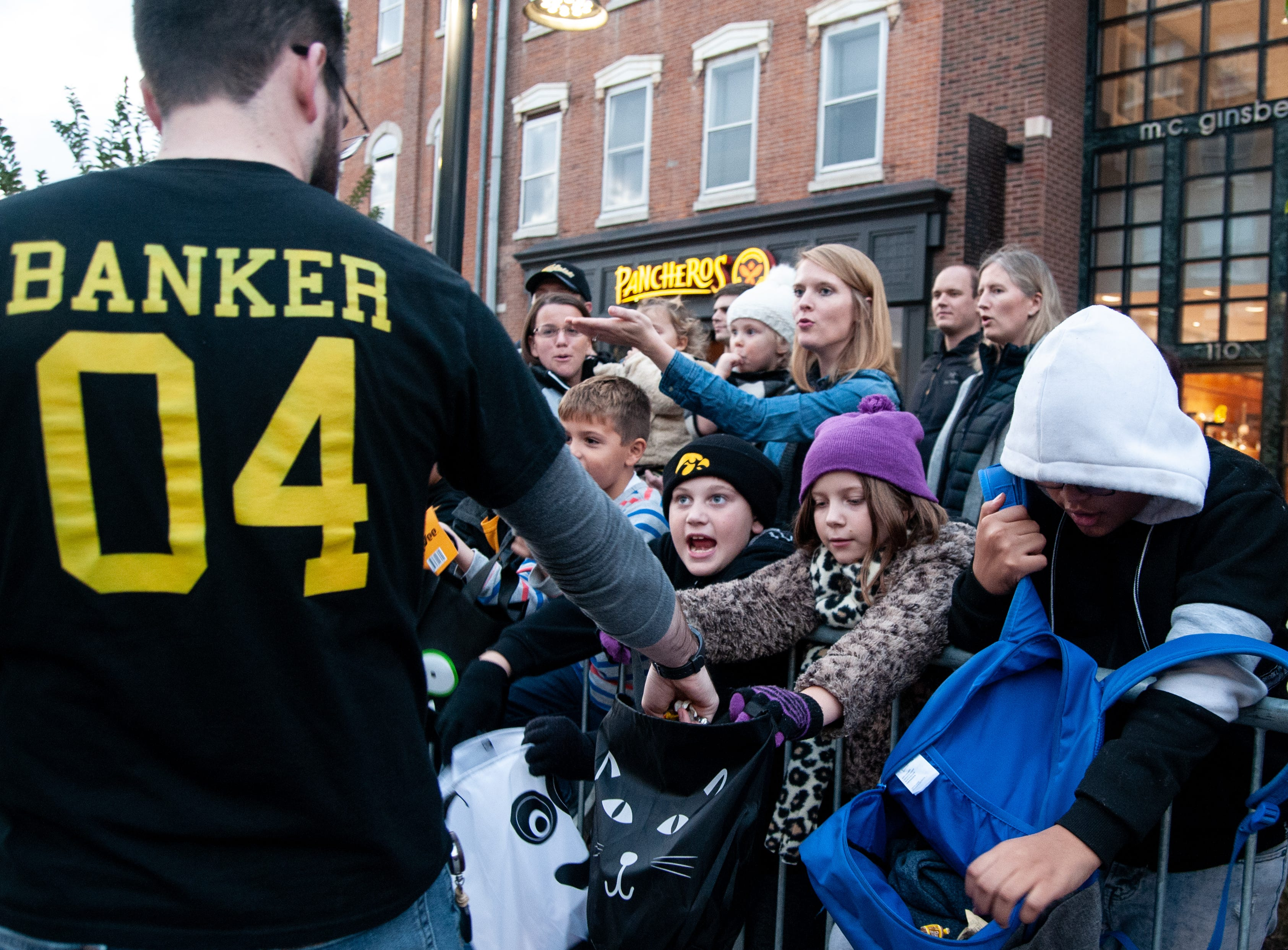 Kids chant for candy during the 2018 Homecoming parade, Friday, Oct. 19, 2018, in Iowa City.