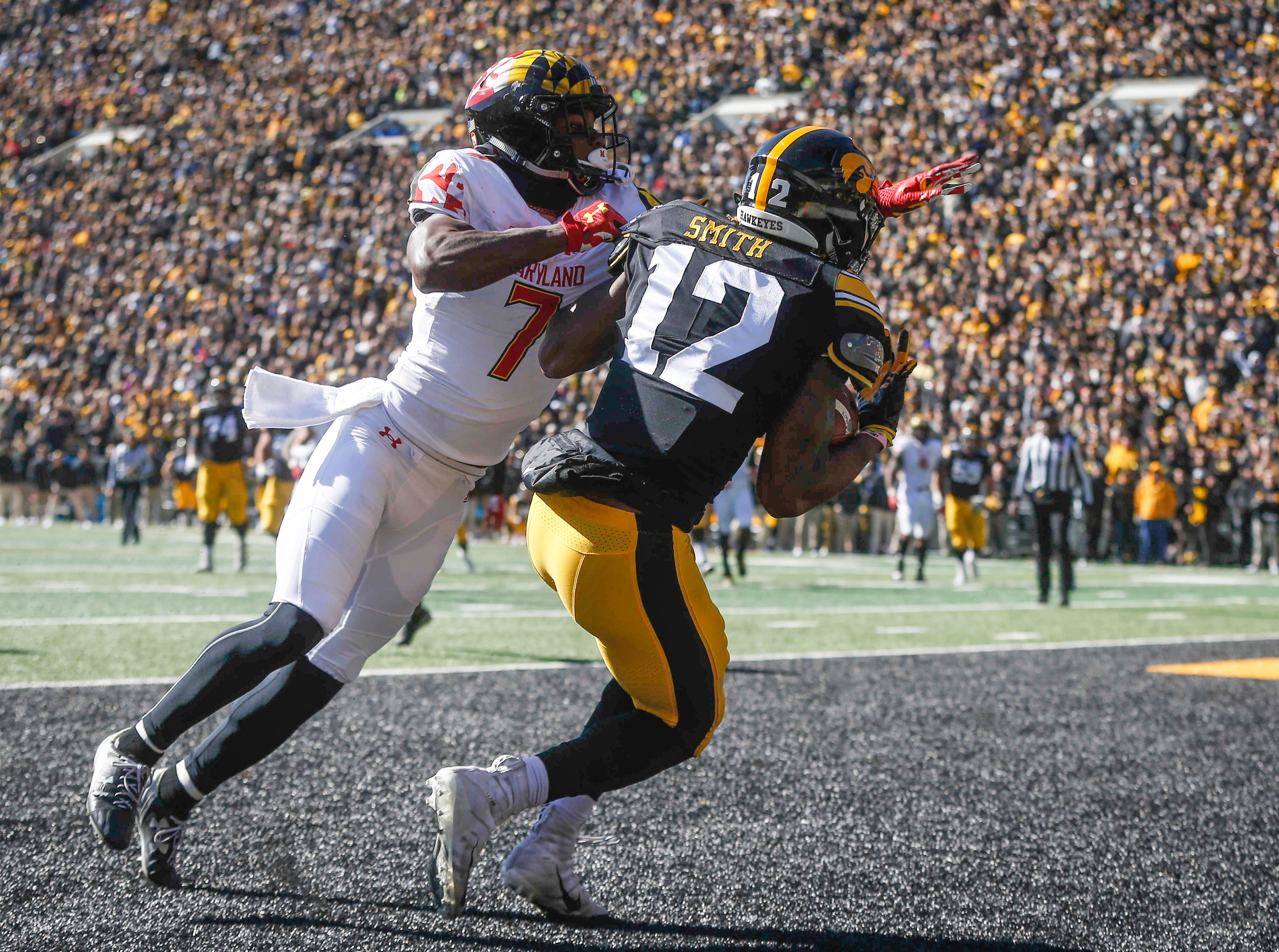 Iowa's Brandon Smith pulls in a touchdown pass in the end zone against Maryland on Saturday, Oct. 20, 2018, at Kinnick Stadium in Iowa City.