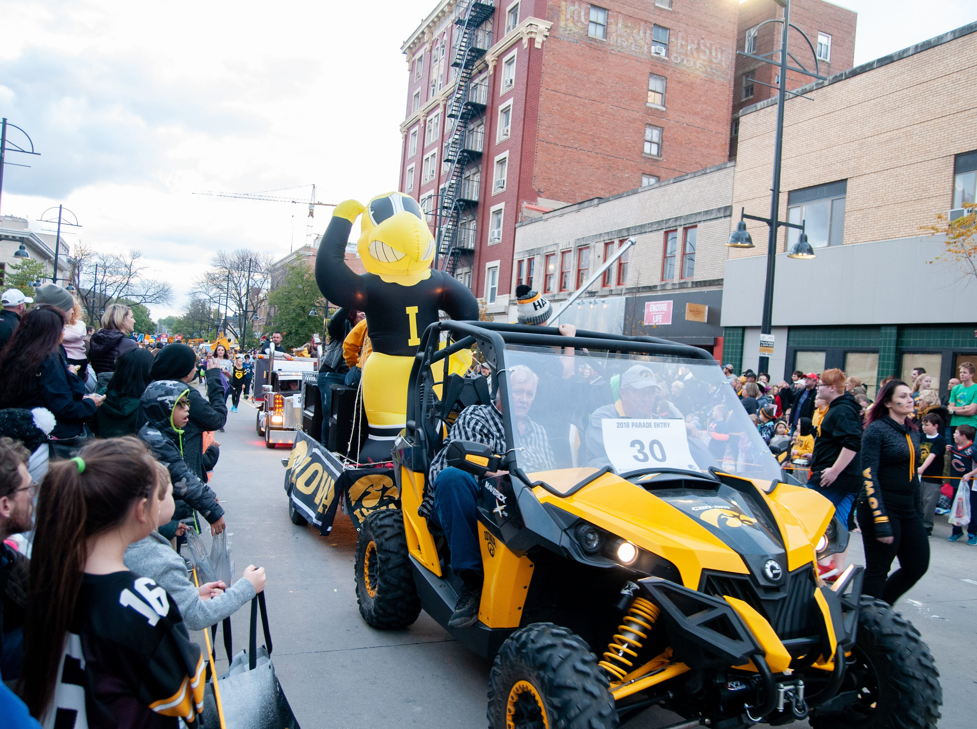 An inflatable Herky rolls through the 2018 Homecoming parade, Friday, Oct. 19, 2018, in Iowa City.