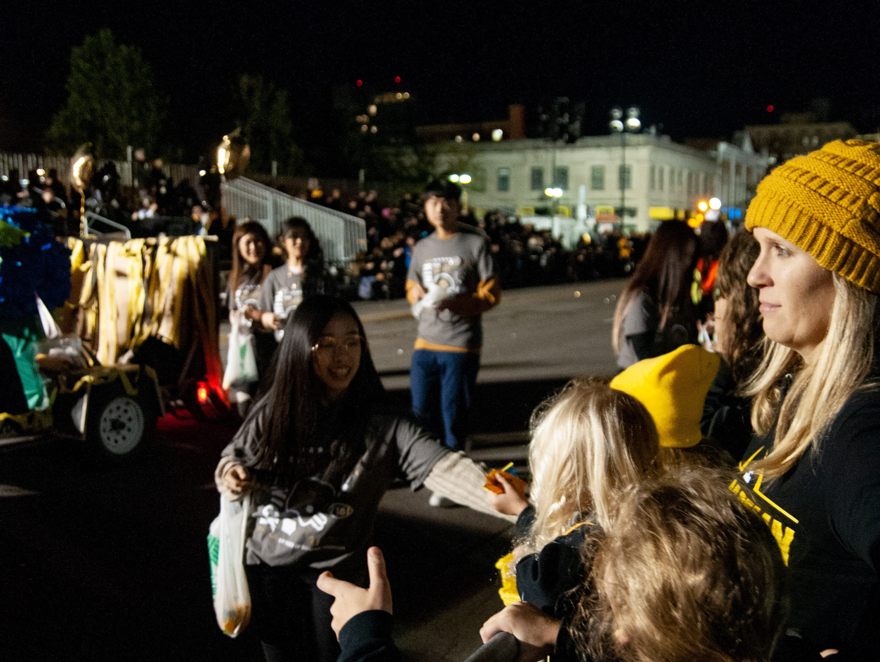 Kids receive candy during the 2018 Homecoming parade, Friday, Oct. 19, 2018, in Iowa City.