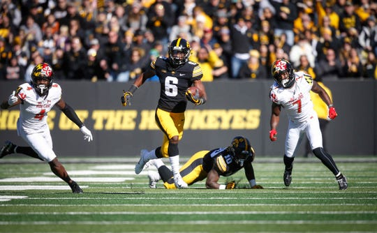 Iowa receiver Ihmir Smith-Marsette carries the ball against Maryland on Saturday, Oct. 20, 2018, at Kinnick Stadium in Iowa City.
