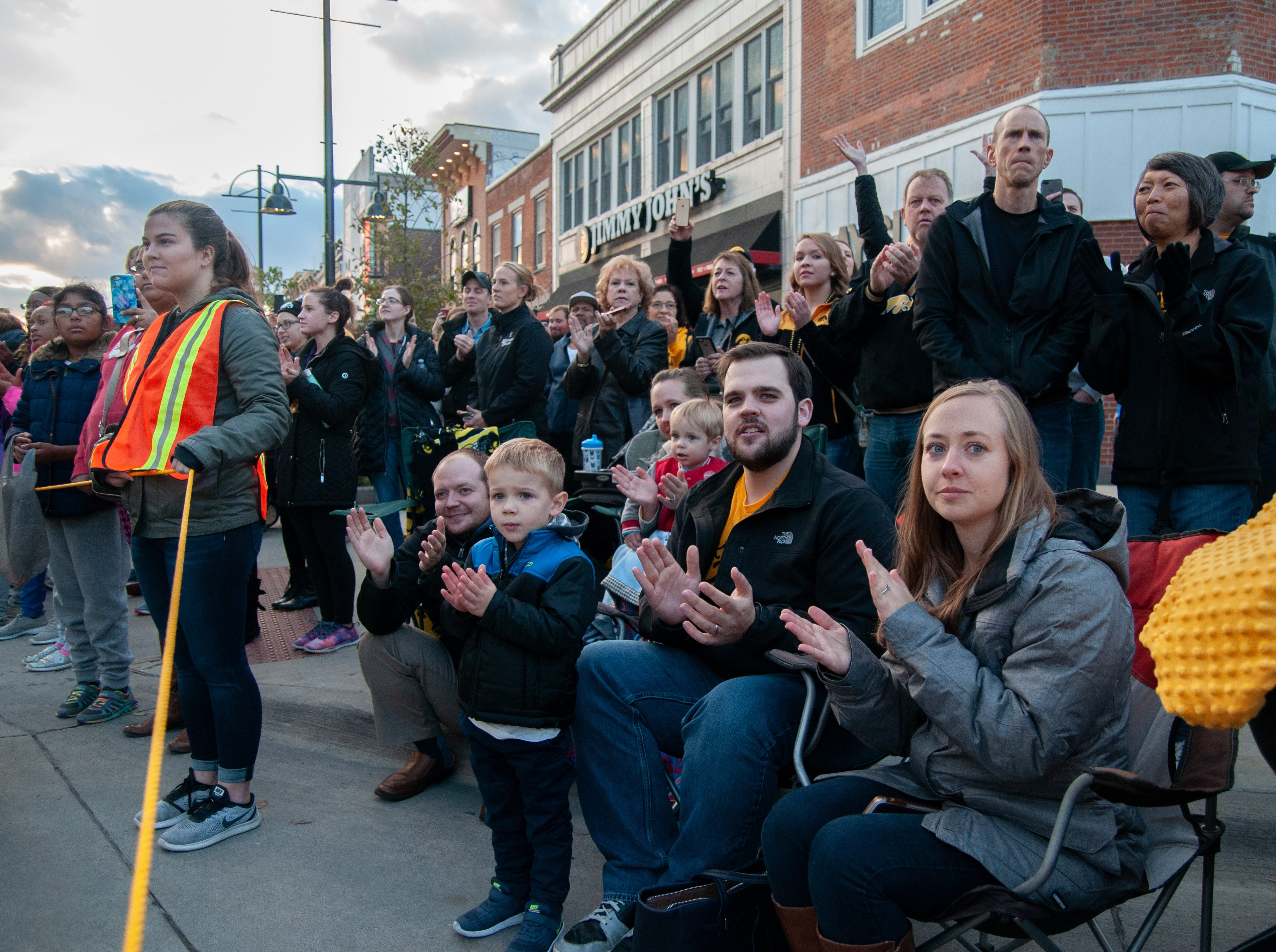"""Crowds cheer to """"Iowa Fight Song"""" during the 2018 Homecoming parade, Friday, Oct. 19, 2018, in Iowa City."""